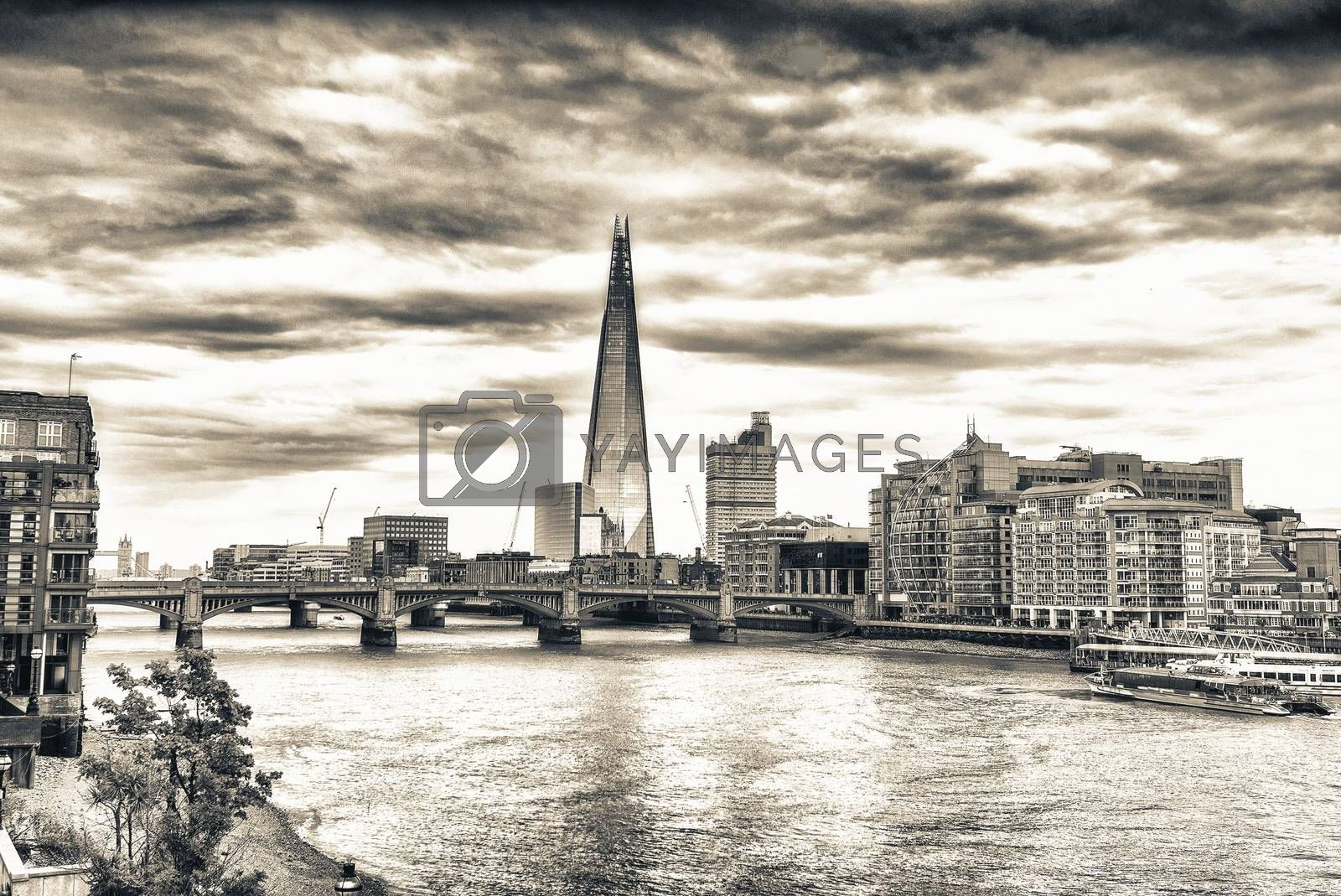 London skyline and Thames river on a cloudy day.