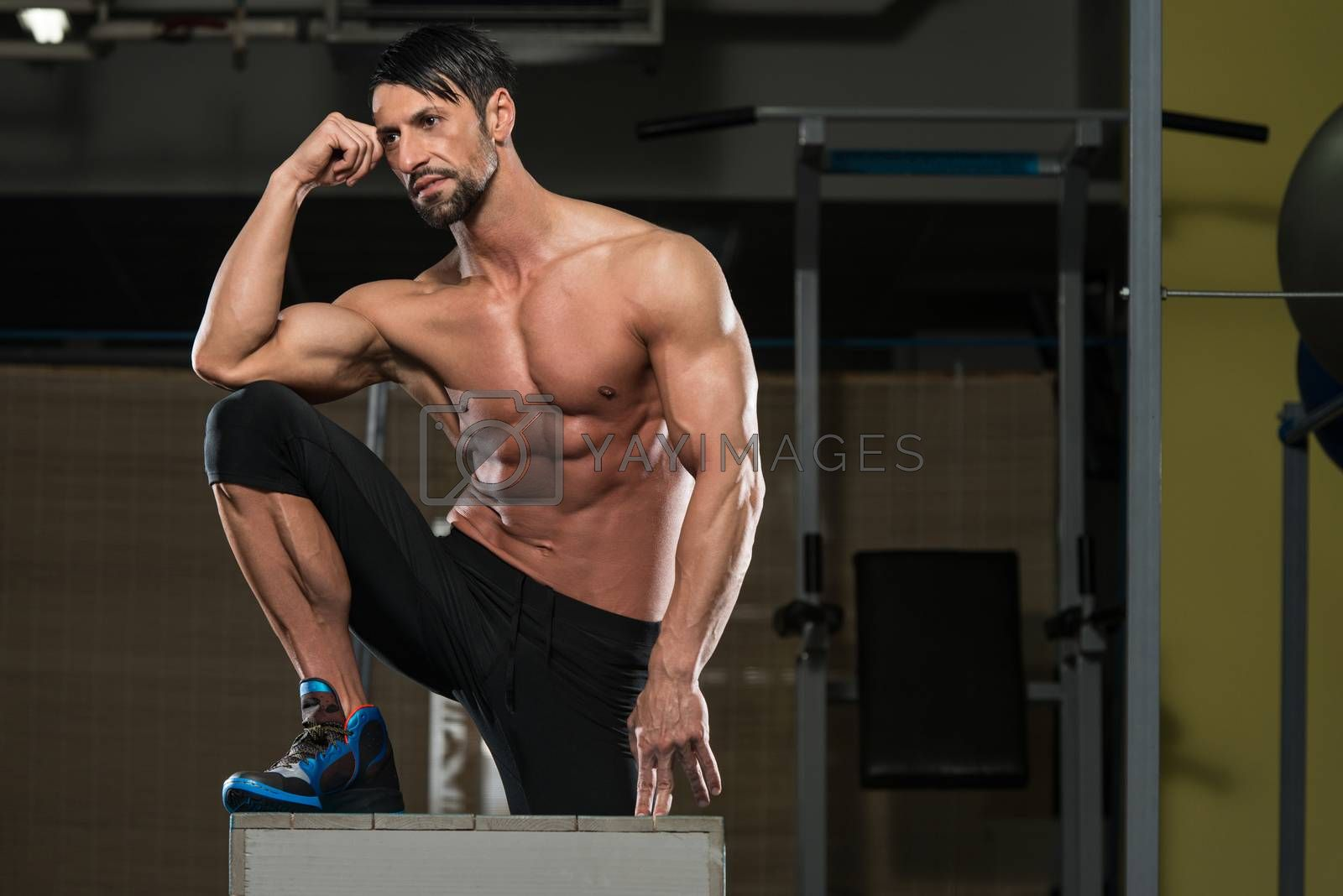 Portrait Of A Physically Fit Young Man Resting After Exercise