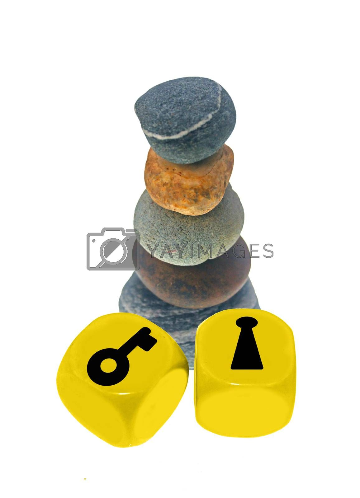 Key and key hole on cubes with Pile of pebble Stones