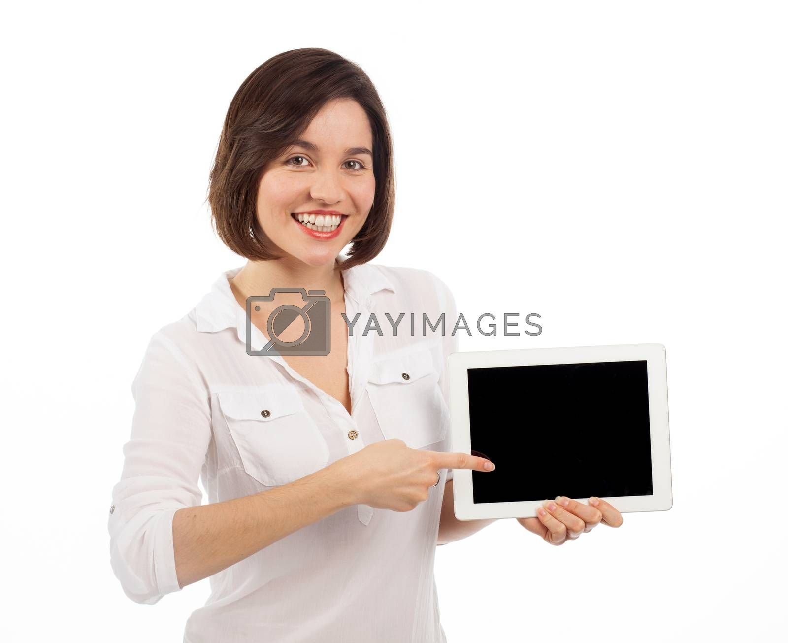 Cute brunette showing a blank touchpad with her finger, communication concept, isolated on white