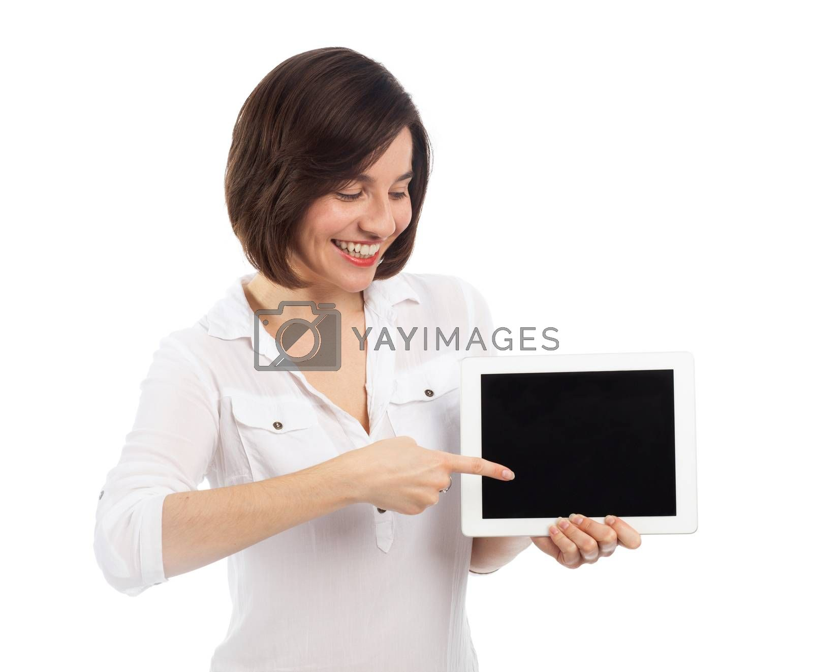 Cute brunette presenting a blank touchpad with her finger, communication concept, isolated on white