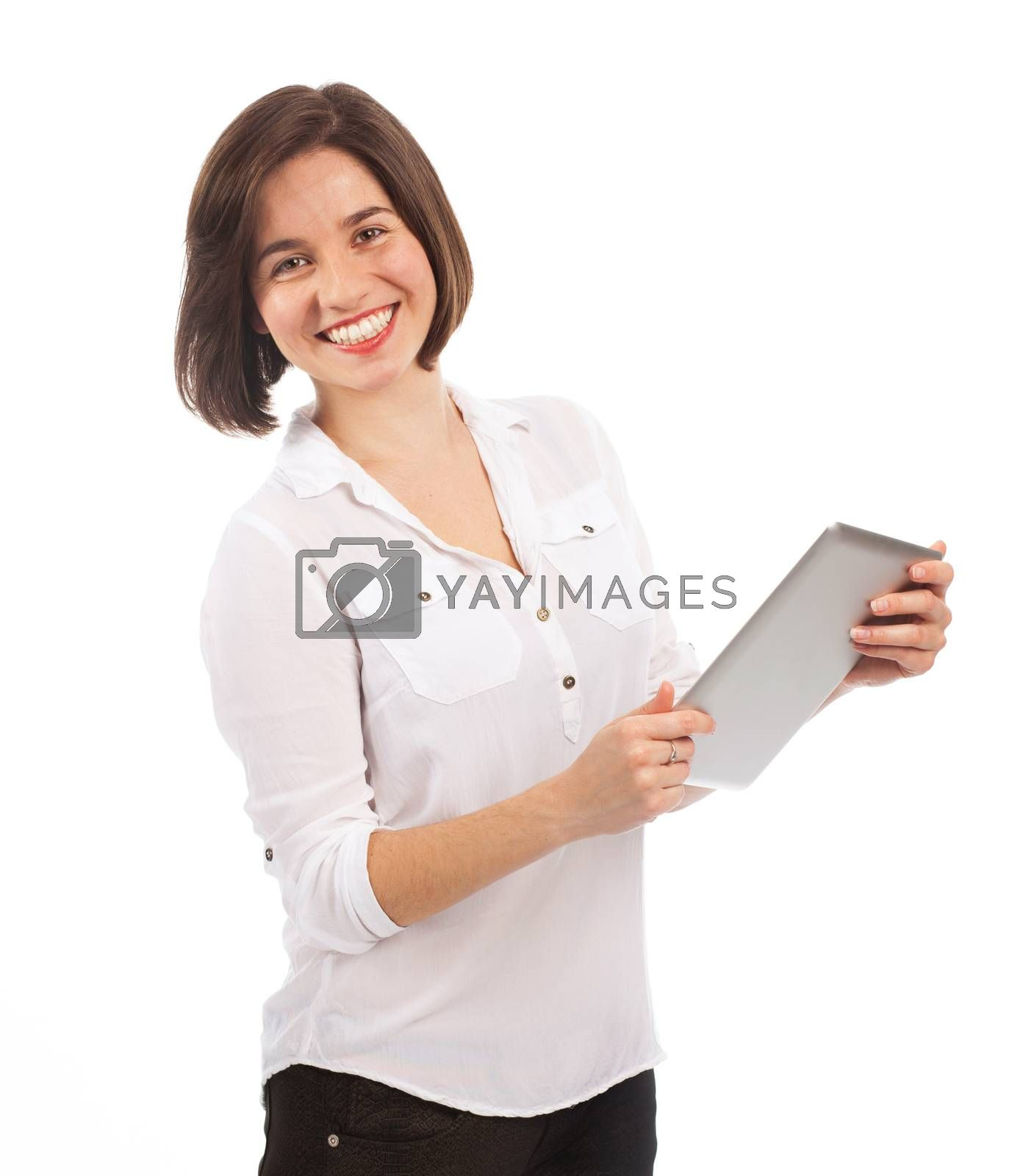 Young smiling brunette using an electronic tablet, isolated on white