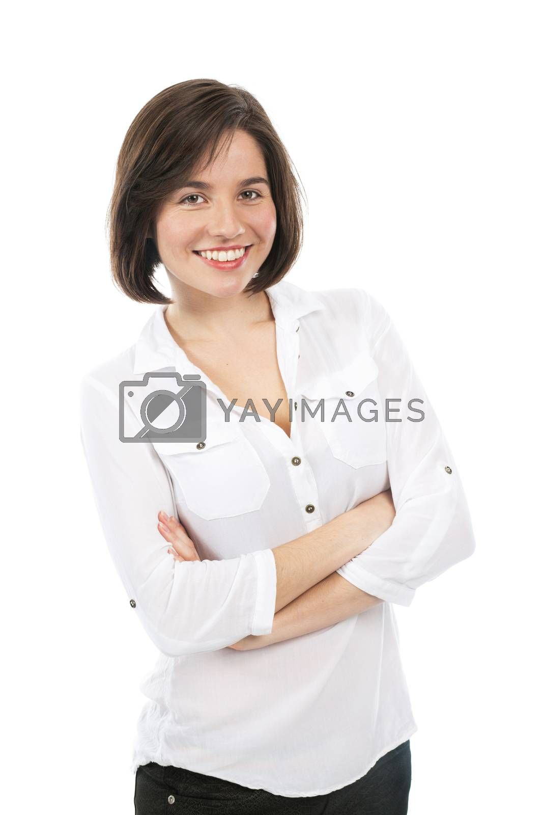 Portrait of a young brunette smiling, with her arms crossed, isolated on white