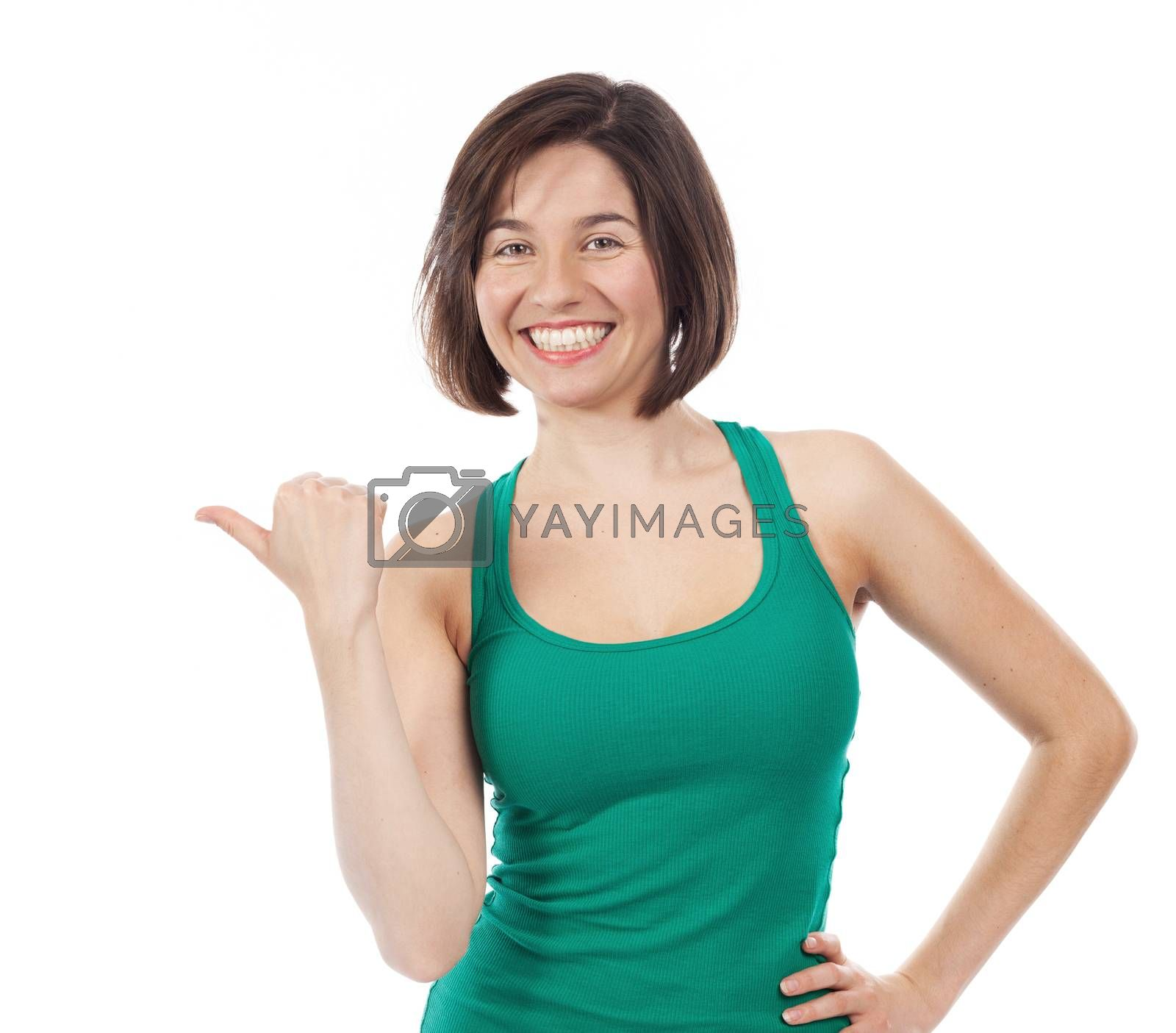 Pretty woman pointing up with her thumb, isolated on white