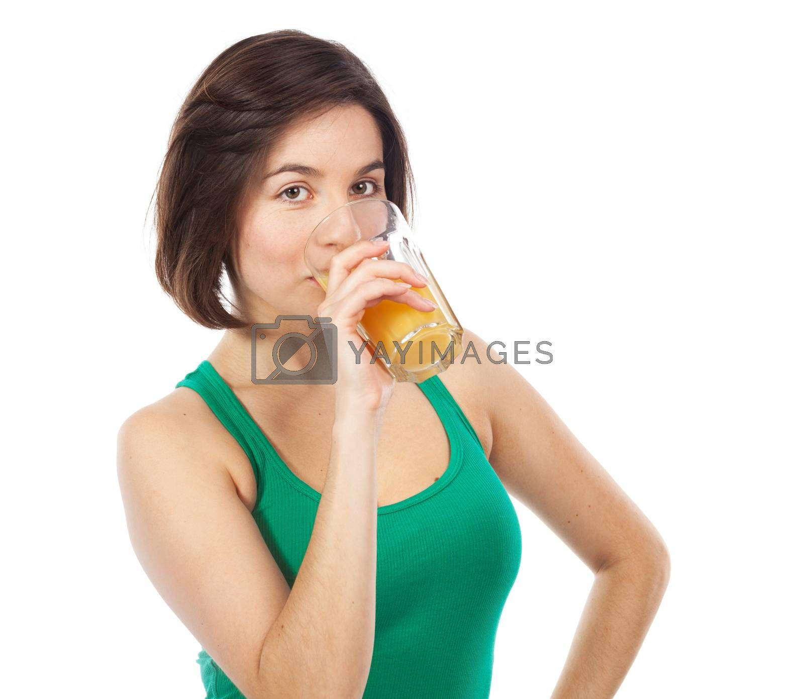 Portrait of a young woman drinking an orange juice, isolated on white
