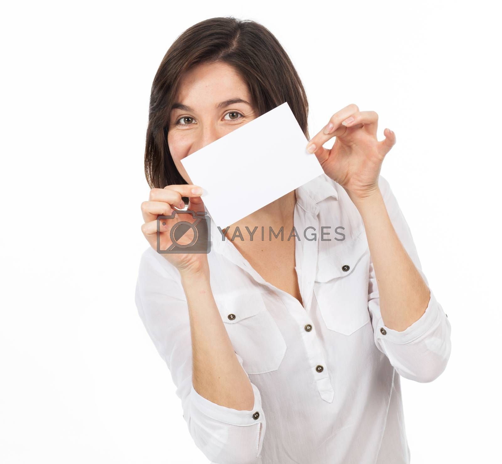 Young brunette presenting a white signboard, isolated on white
