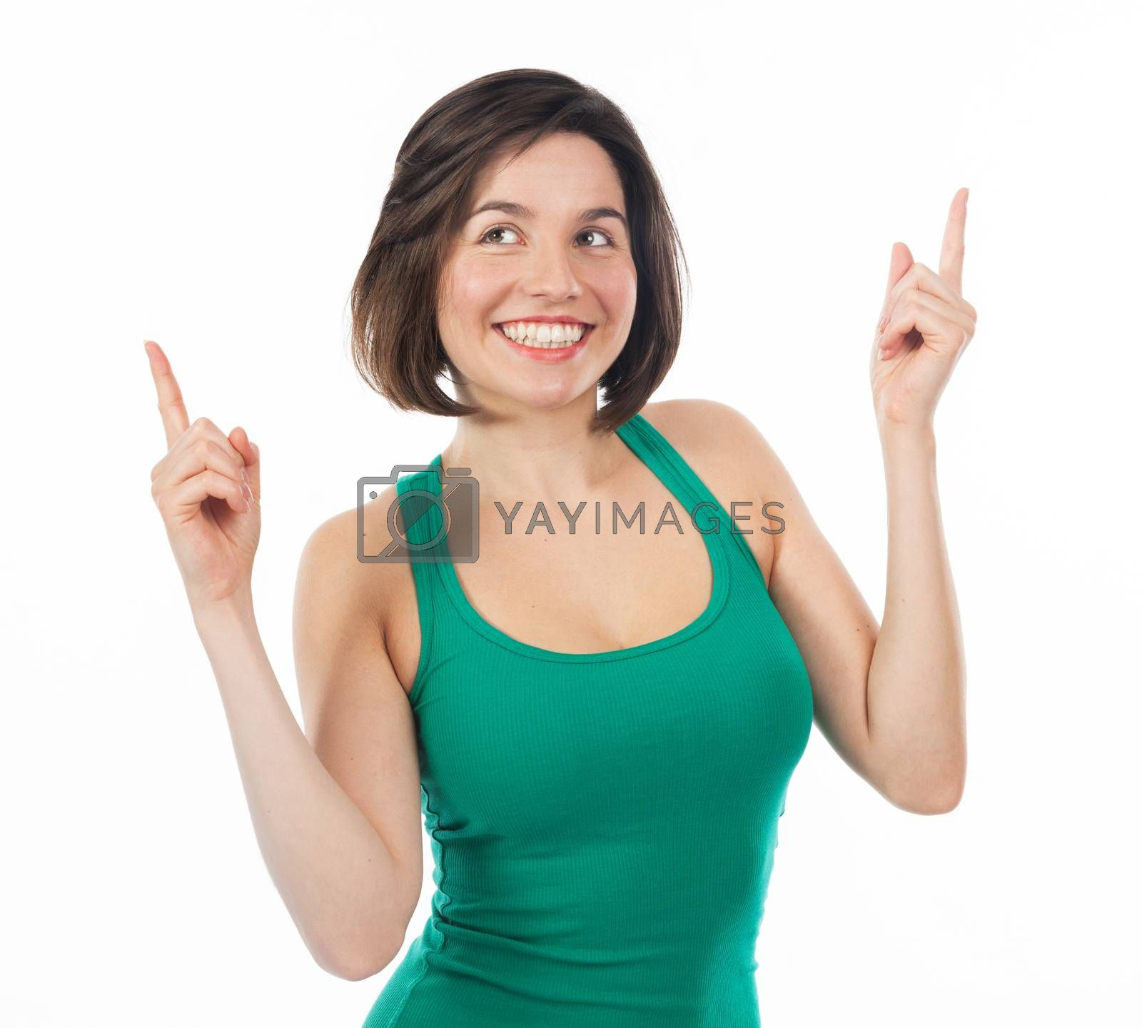 Cheerful brunette pointing something up, isolated on white