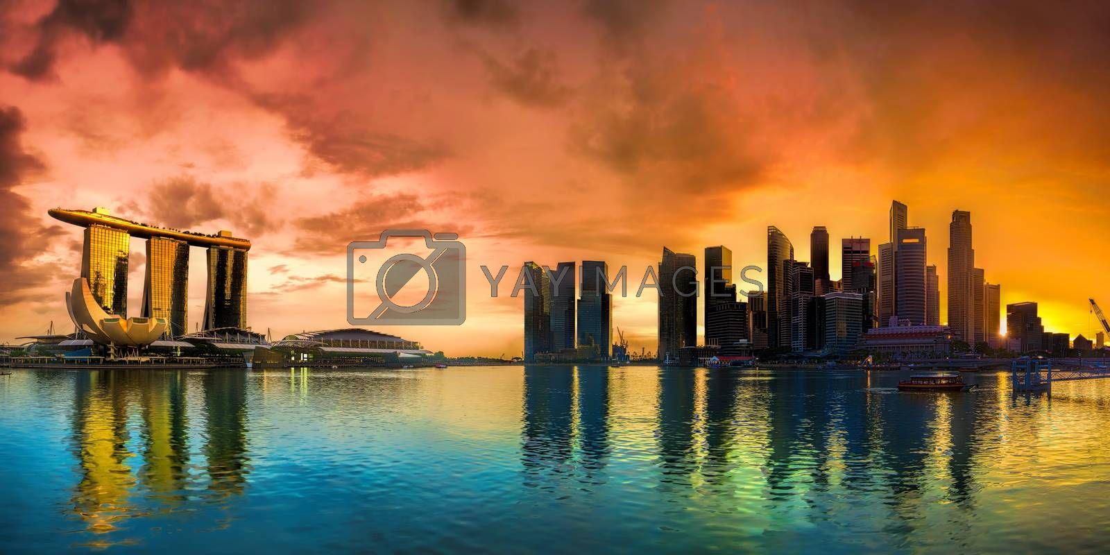 Panorama of Singapore city skyline at sunset