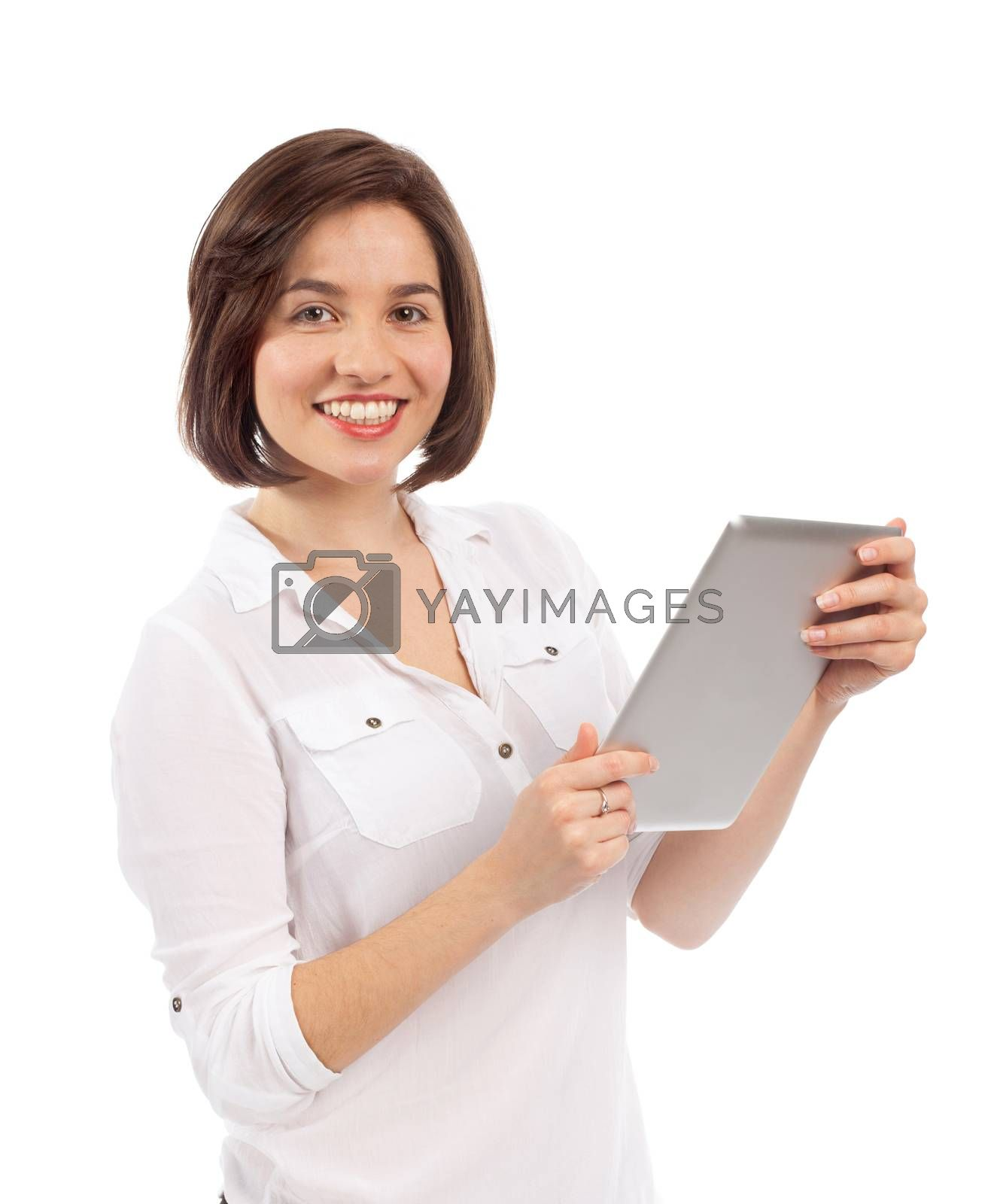 Cute brunette surfing on the web with a touchpad, isolated on white