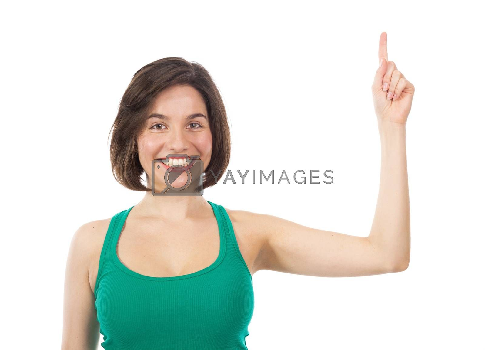 Happy woman displaying something with her finger, isolated on white