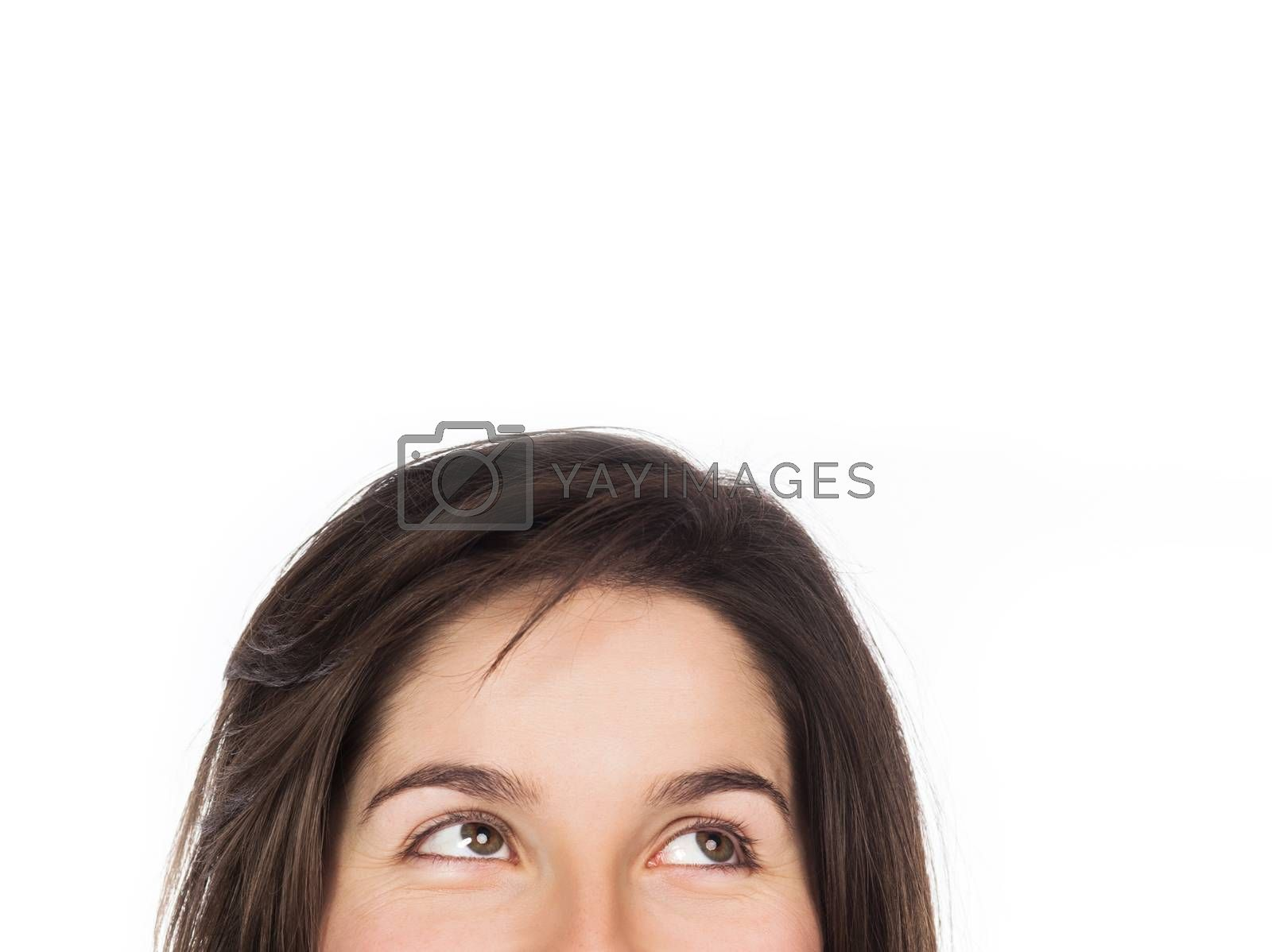 Close-up view of eyes looking up, copy space, isolated on white