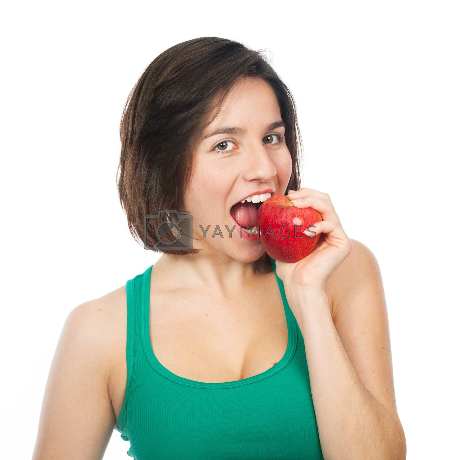 Beautiful young woman eating a red apple, isolated on white