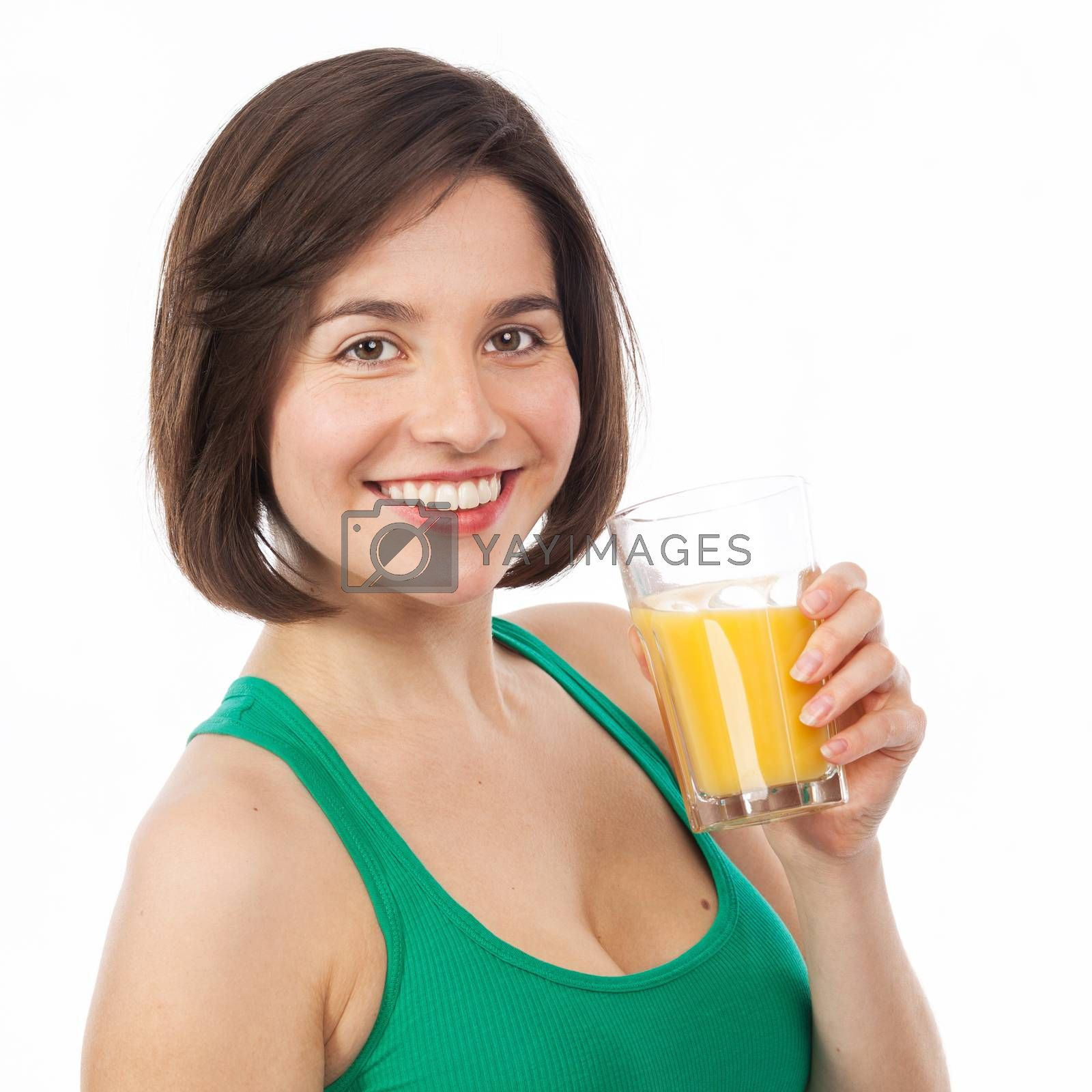 Portrait of a pretty brunette drinking an orange juice, isolated on white