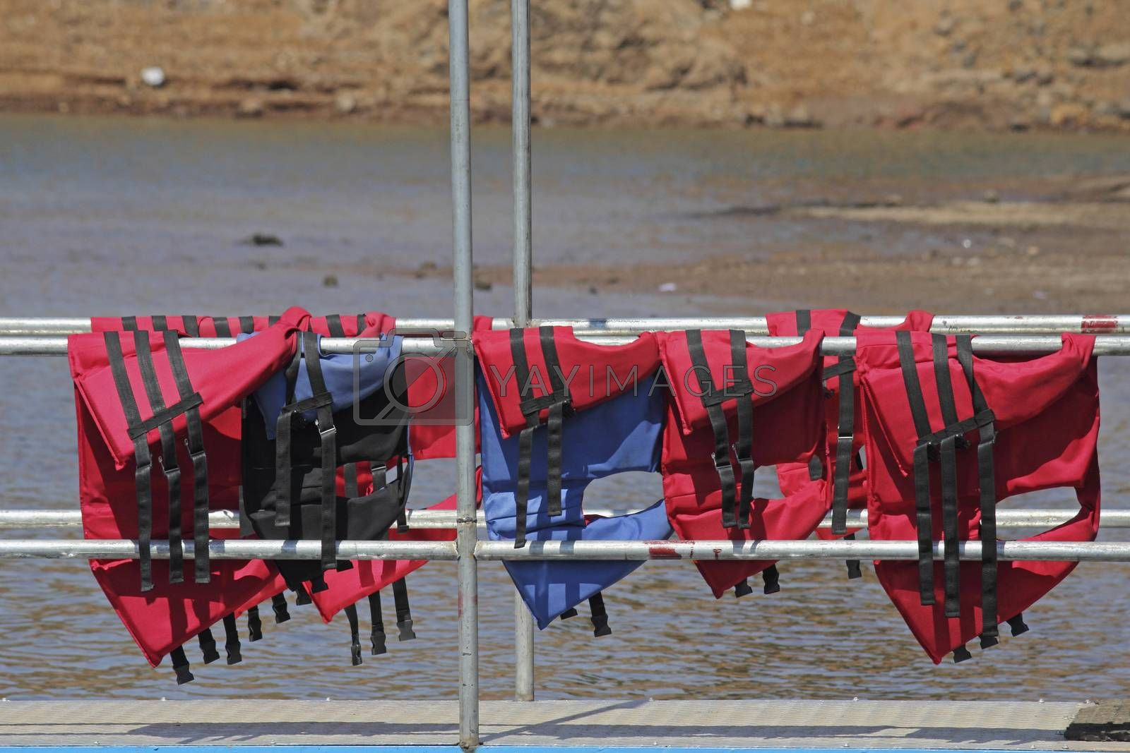 Royalty free image of Buoyancy jackets on a rail by yands