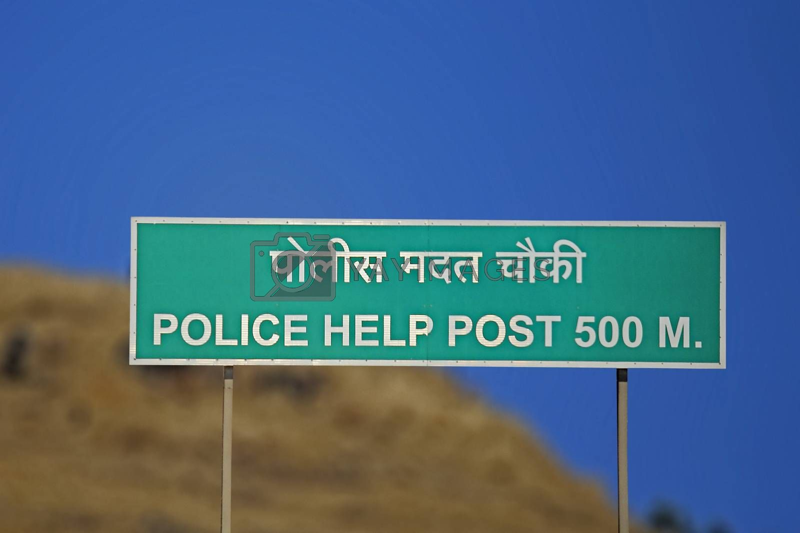Royalty free image of police help post road side board by yands