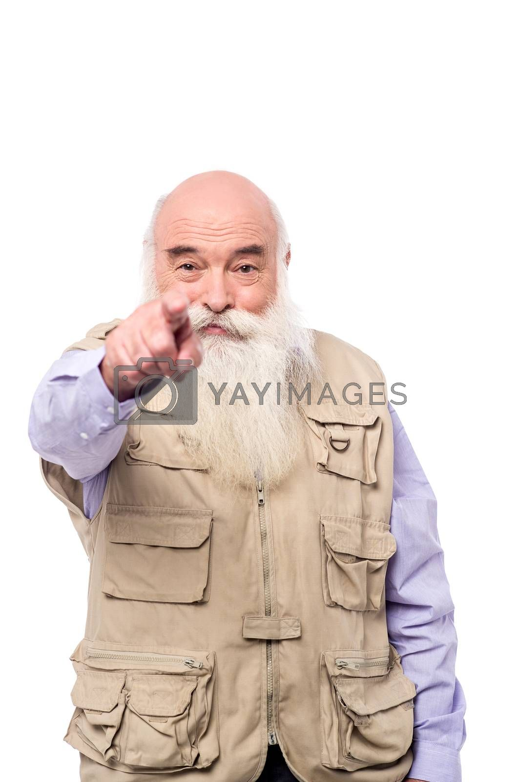 Senior man pointing towards you by stockyimages