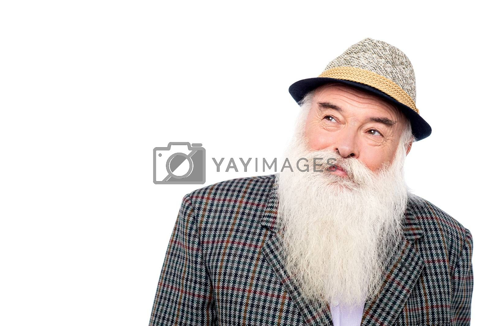 Royalty free image of Old man with hat, looking up. by stockyimages
