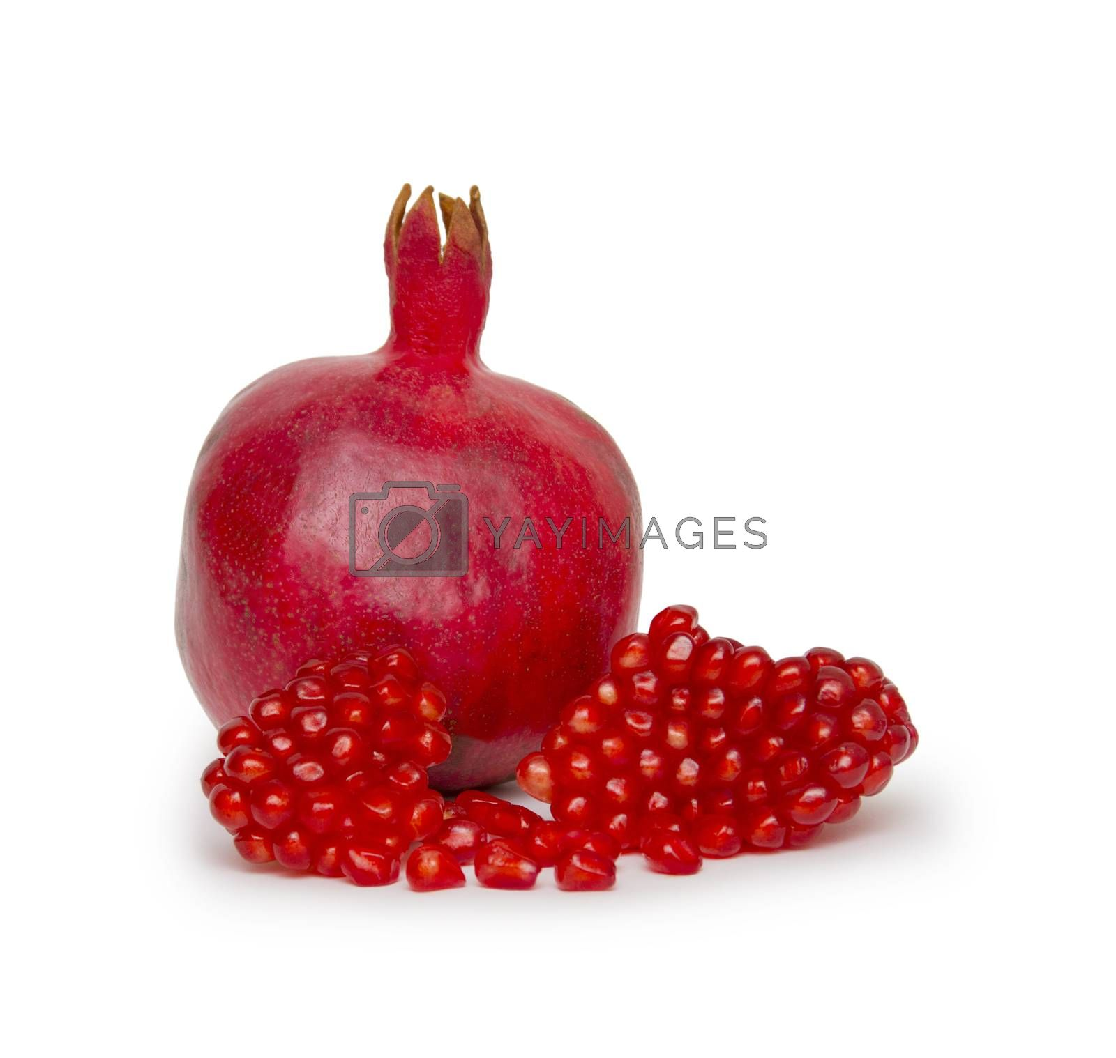 Royalty free image of Ripe pomegranate fruit isolated on white background cutout by cocoo