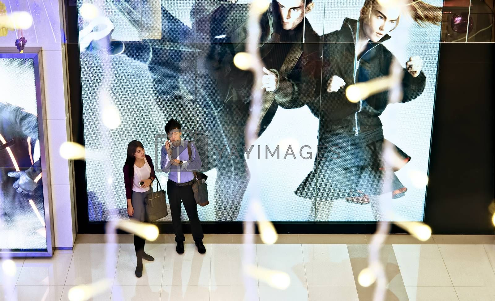Royalty free image of Young Couple doing Xmas shopping in a mall by zkruger