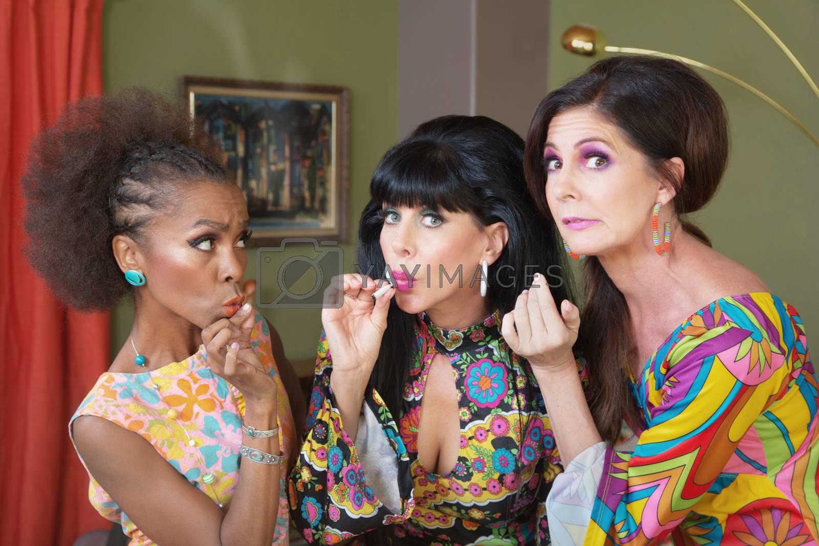 Royalty free image of Dishonest Ladies Smoking by Creatista