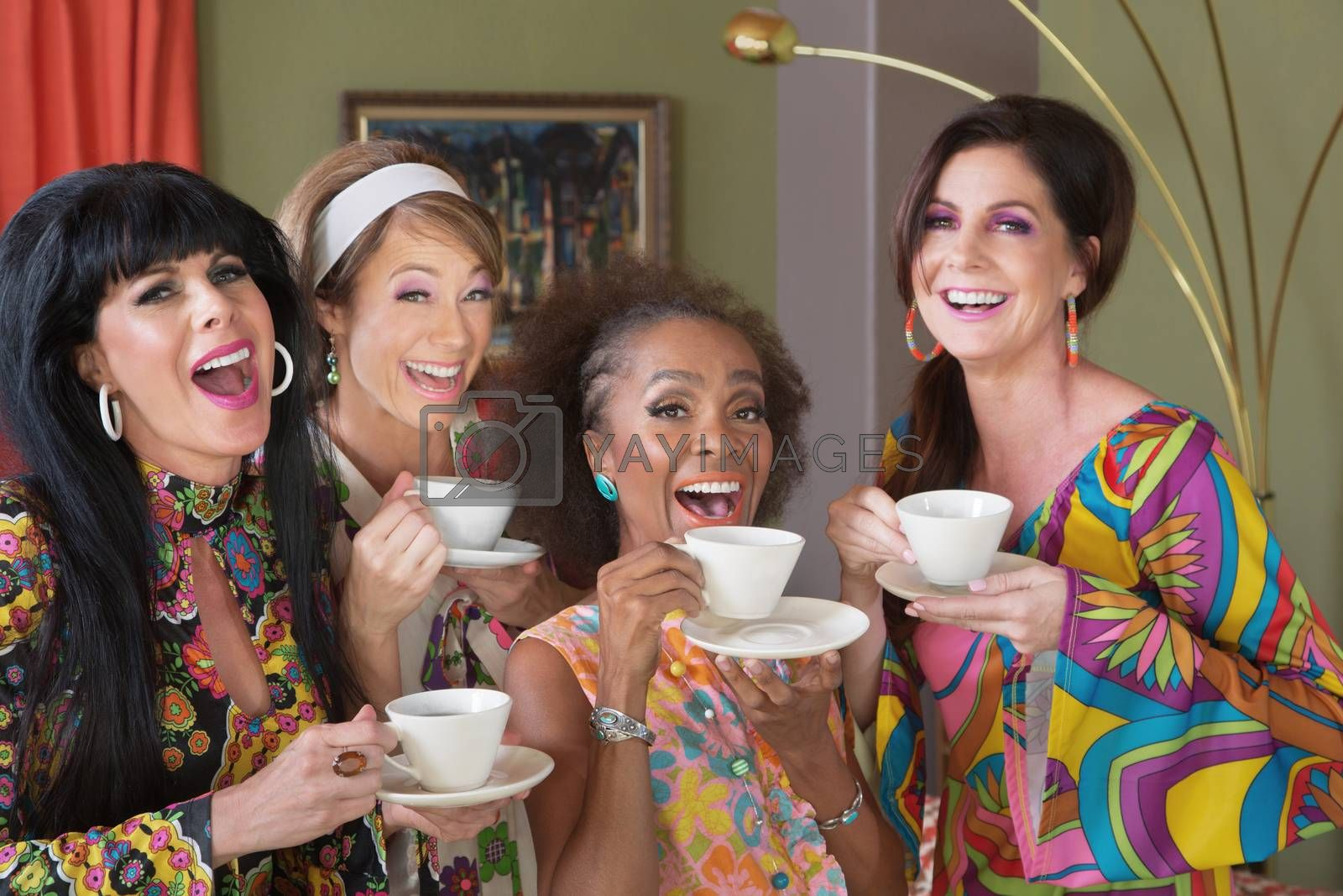 Royalty free image of Four Happy Women Drinking Tea by Creatista