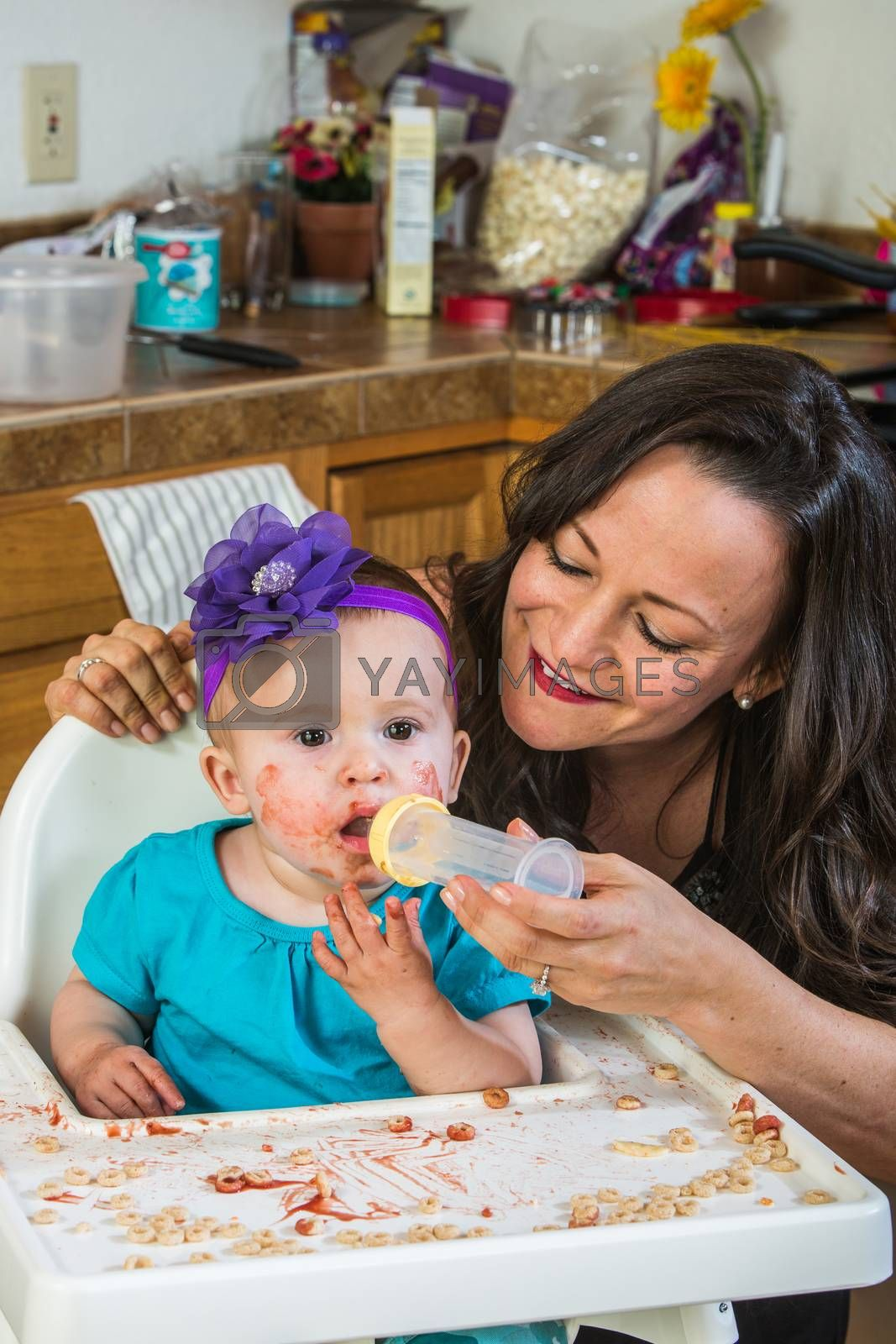 Royalty free image of Woman Feeds Baby by Creatista