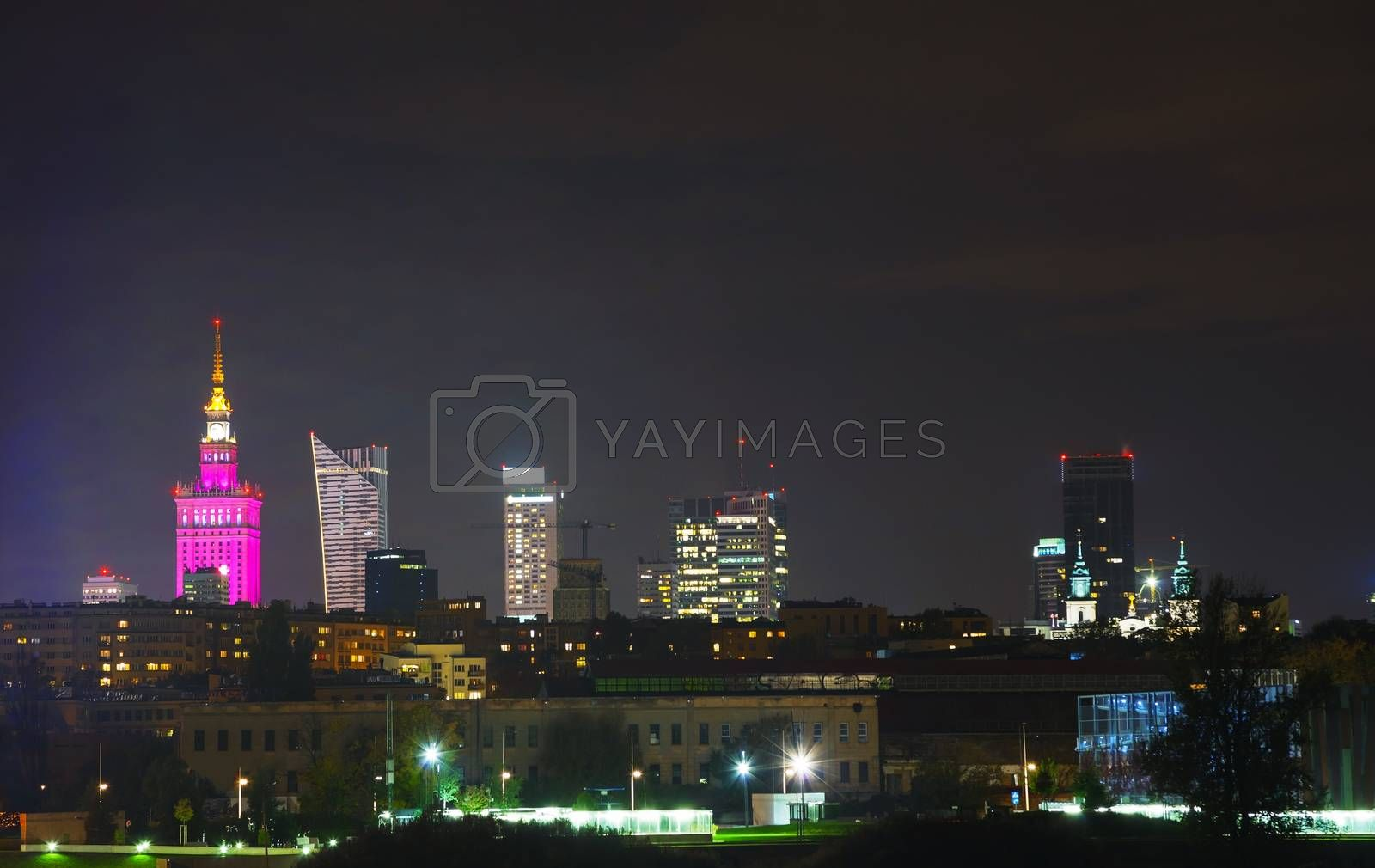 Royalty free image of Warsaw cityscape at night by AndreyKr