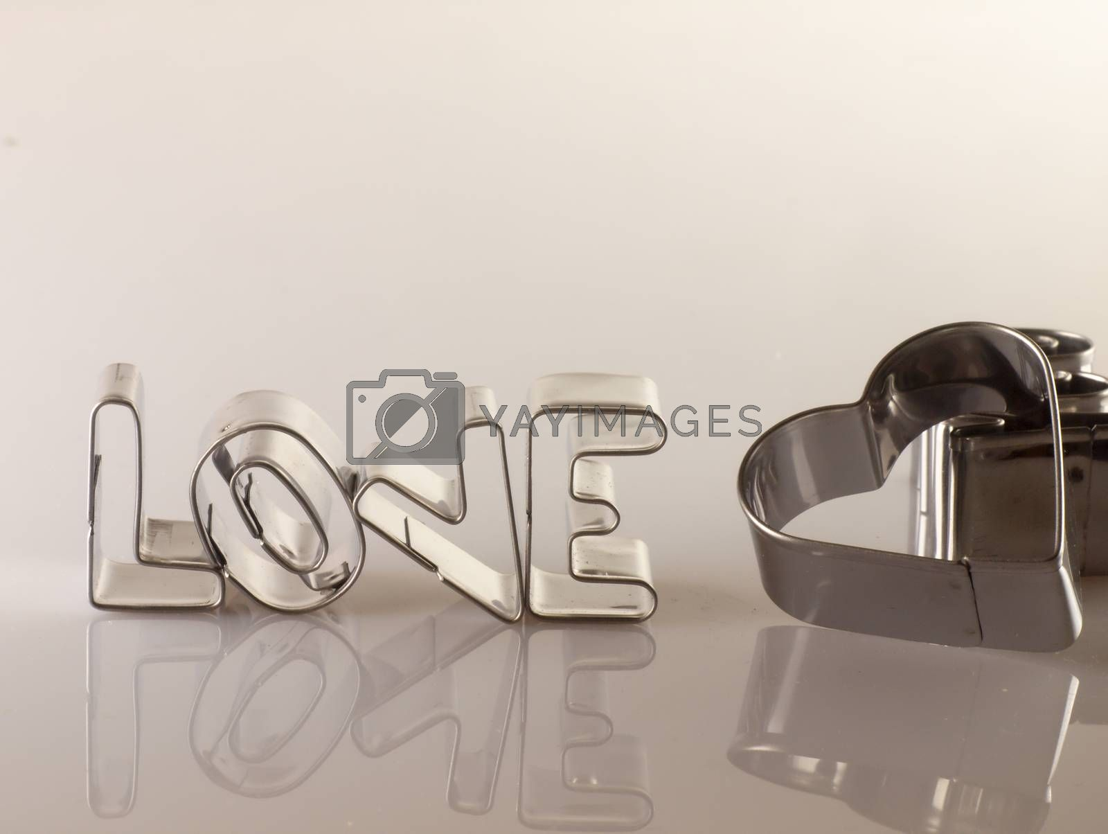 Royalty free image of Word love from the molds to the dough. by kamiwro