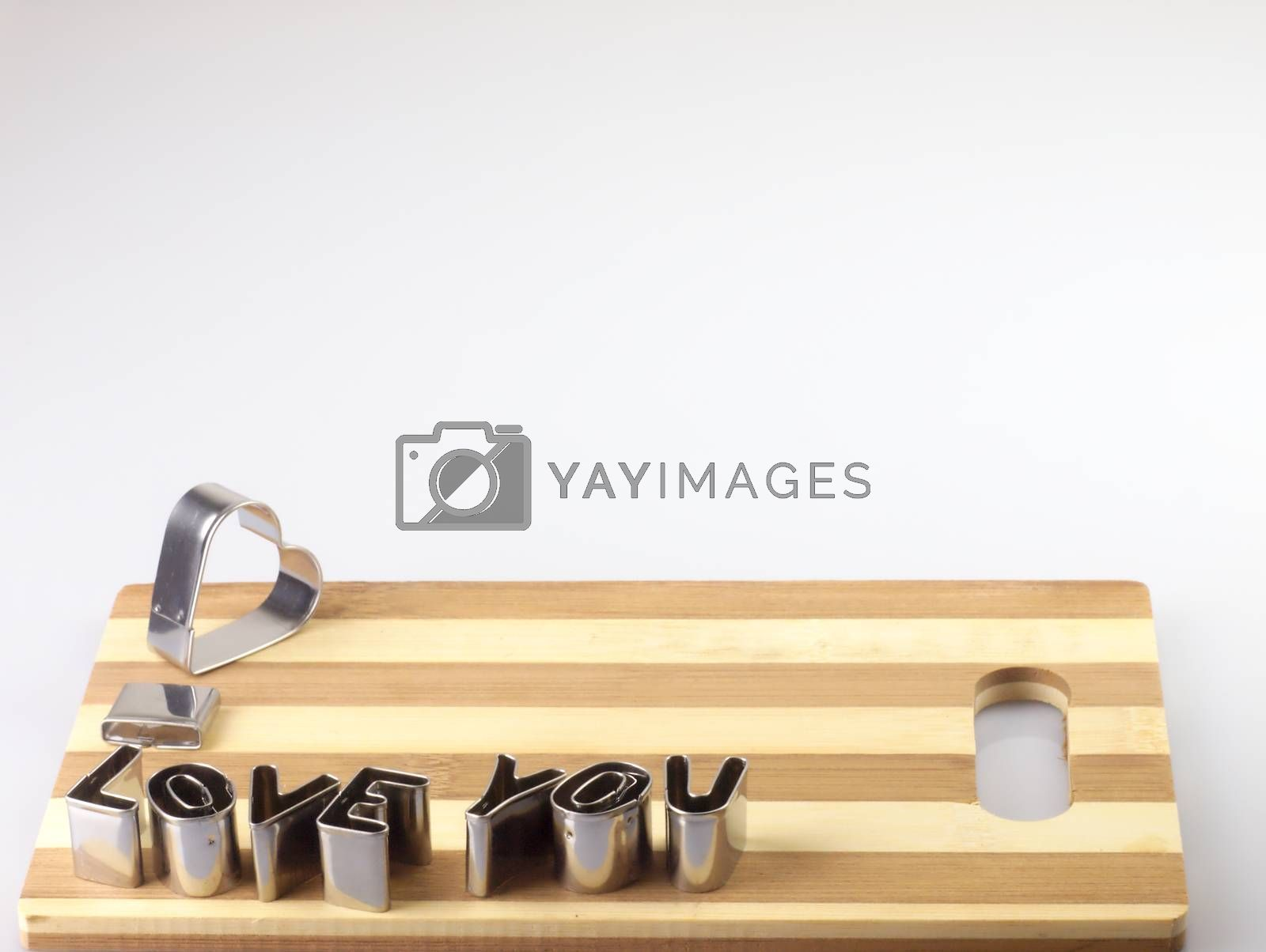 Royalty free image of Love and bread cutting board. by kamiwro