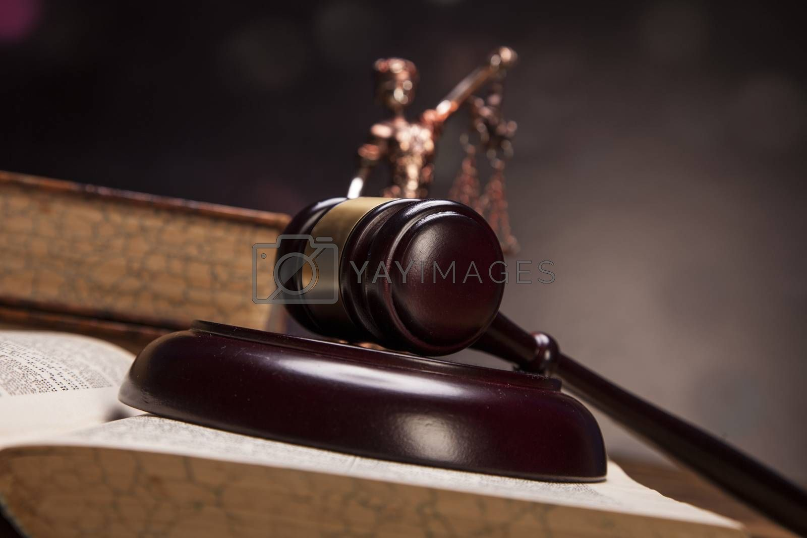 Scales of justice and gavel on desk with dark background by fikmik