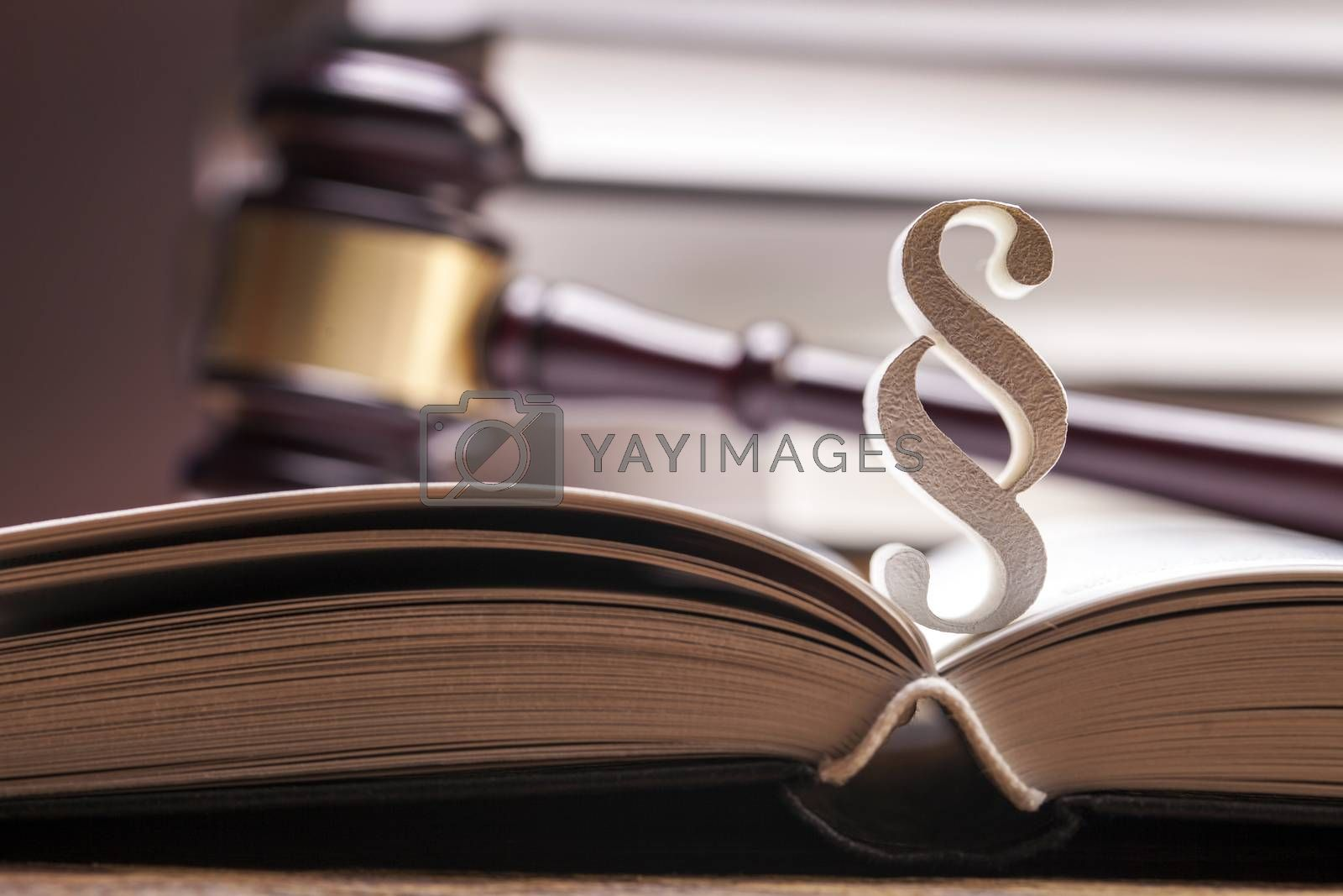 Royalty free image of Scales of justice and gavel on desk with dark background by fikmik