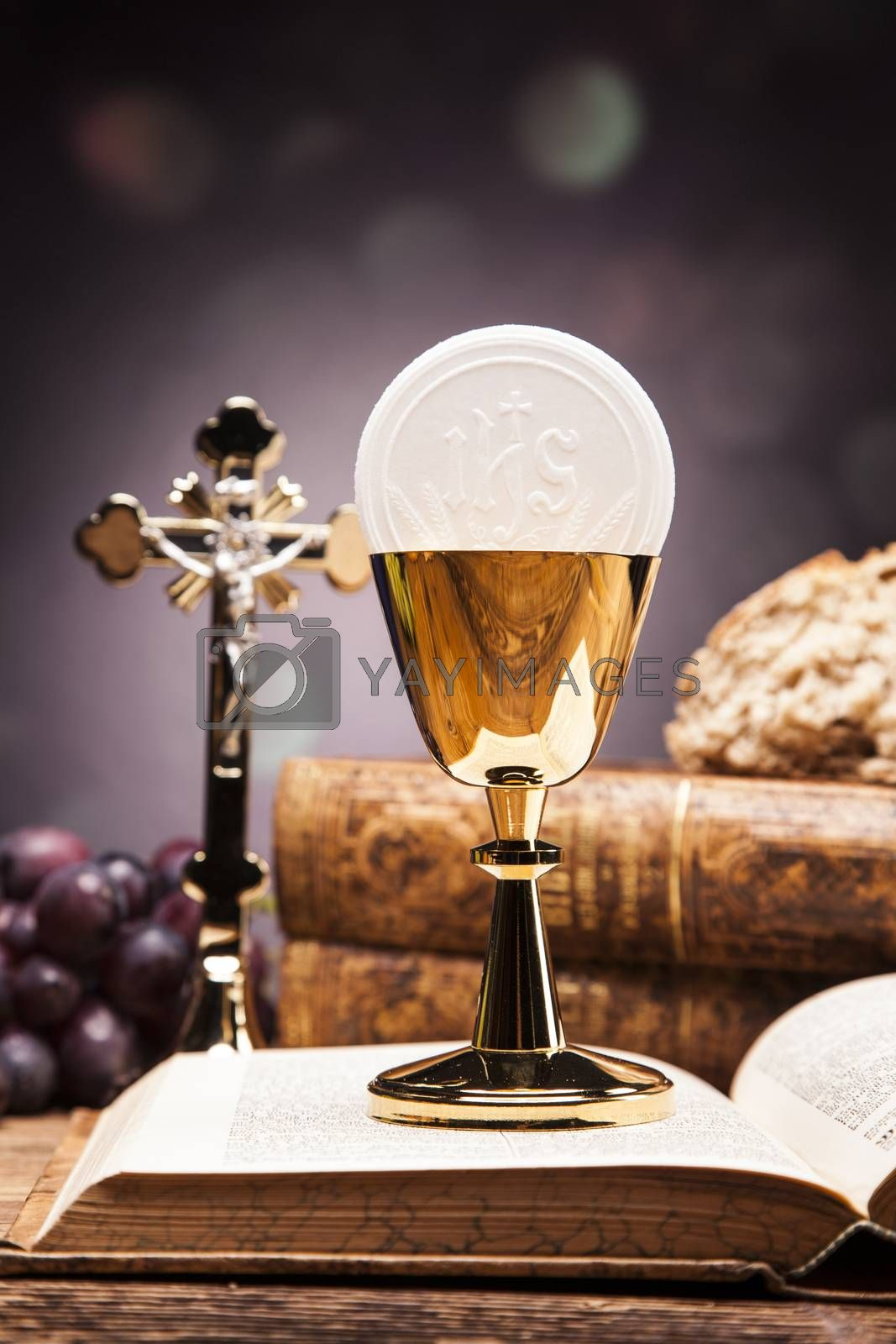 Royalty free image of Christian religion, wine, bread and the word of God on yellow background by fikmik