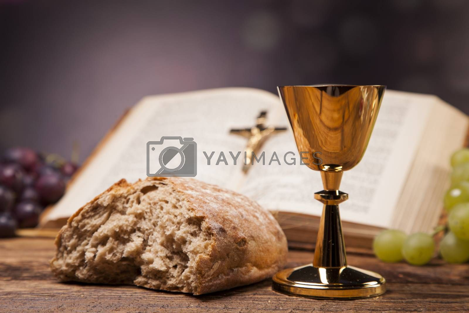 Christian religion, wine, bread and the word of God on yellow background by fikmik