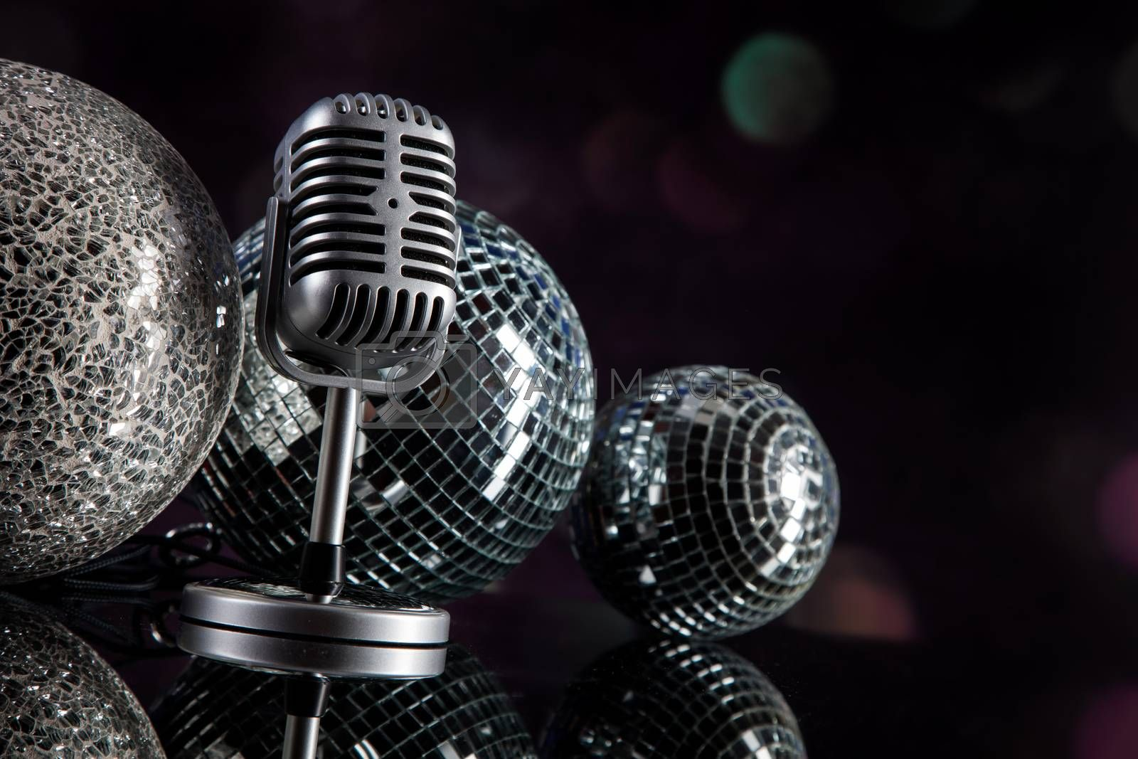 Royalty free image of professional silver microphone by fikmik