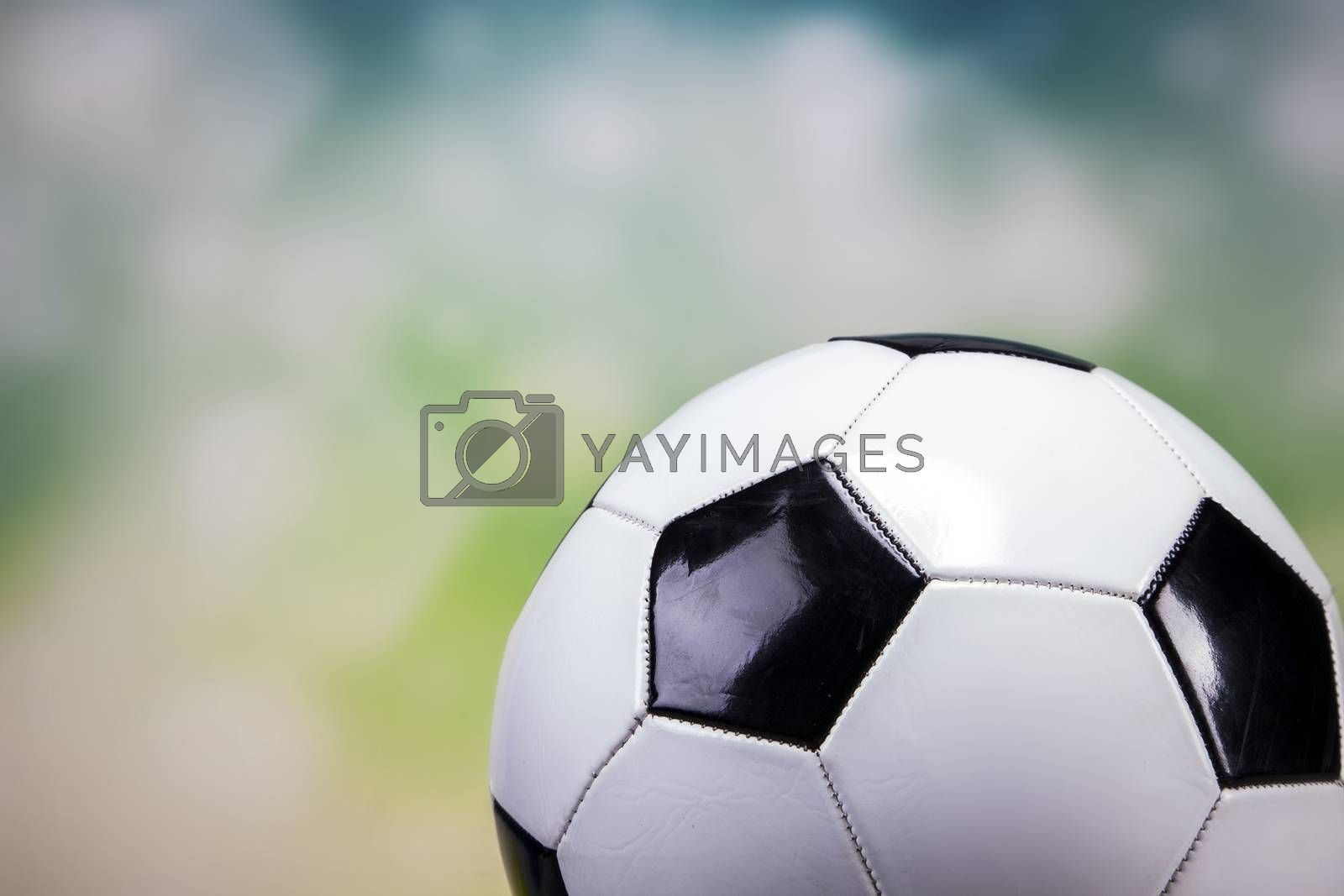 Royalty free image of Football on colorful background by fikmik