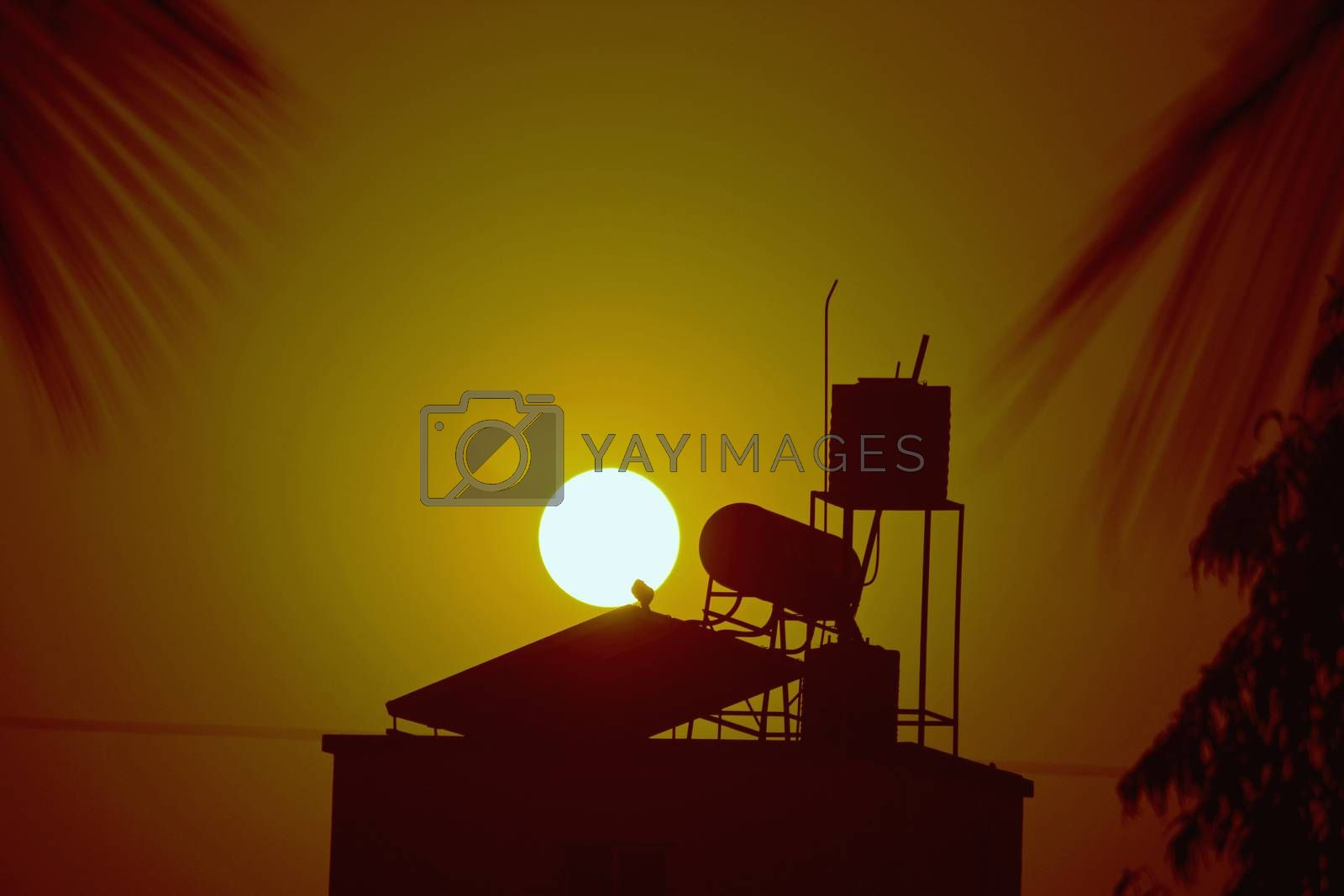 Royalty free image of sun with water heater solar panel by yands