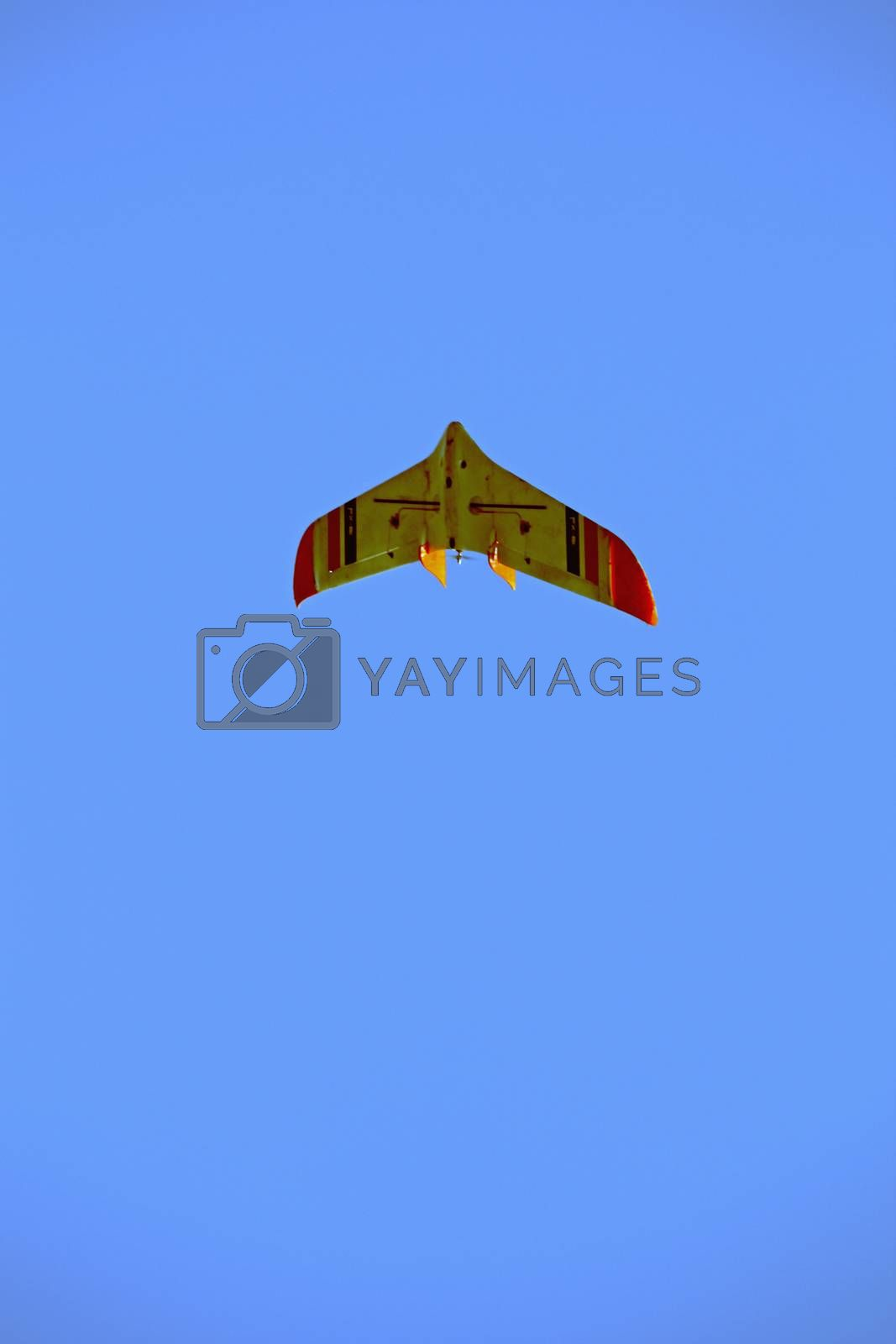 Royalty free image of RC model airplane flying by yands