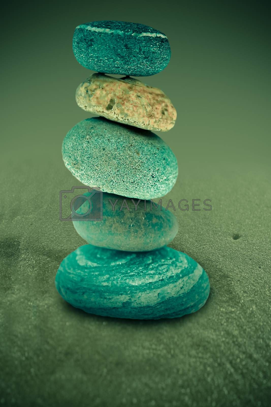 Five stones balanced on top of eachother