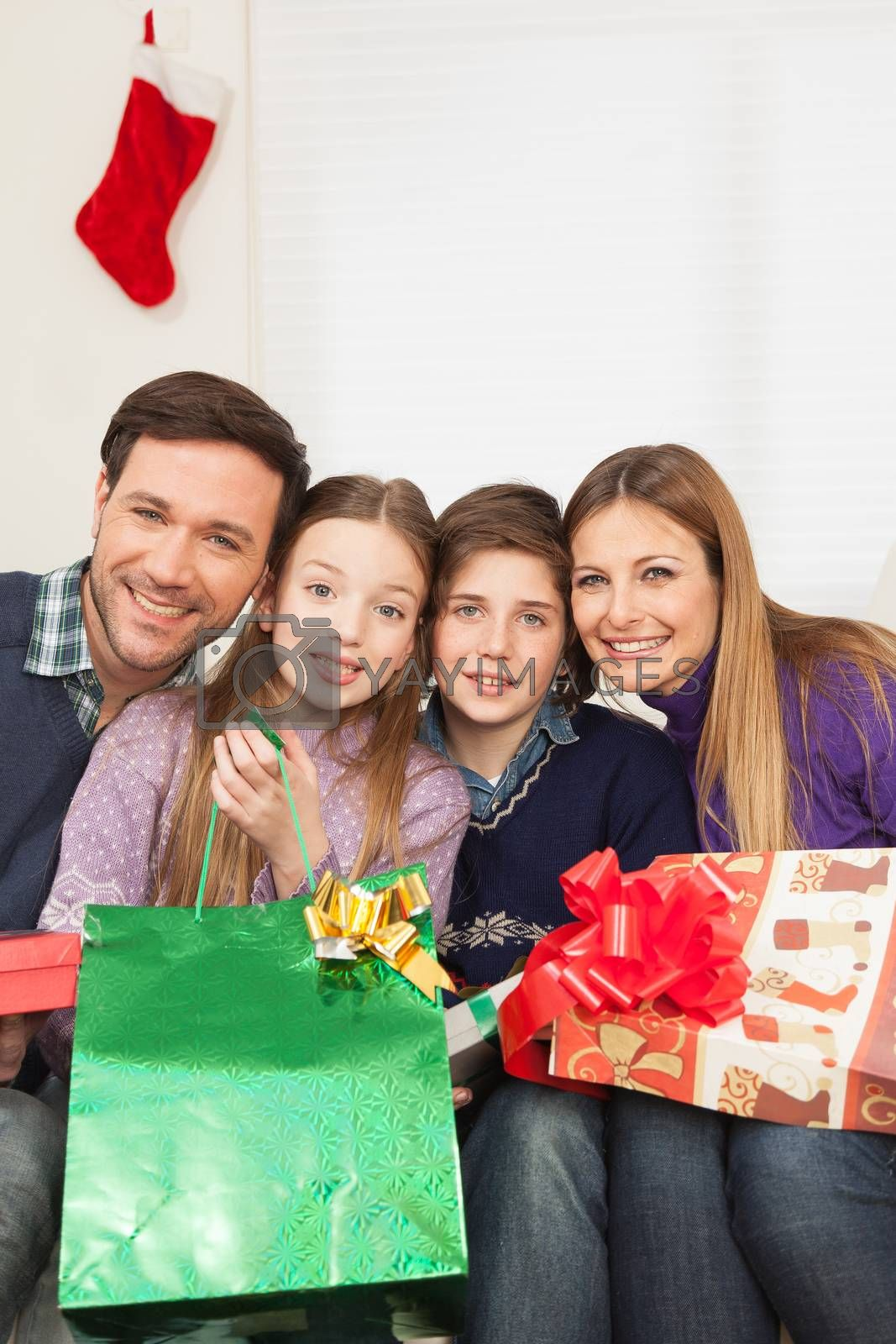 10-12, 30-35, 8-10, adorable, affection, background, beautiful, beauty, boy, camera, care, casual, caucasian, celebration, child, children, christmas, couch, cute, daughter, decoration, face, family, father, front, fun, gift, girl, golden, green, happiness, happy, holidays, home, vertical, joy, kid, laughing, little, look, looking, love, male, man, model, mom, mother, old, one, people, person, portrait, property, red, releases, ribbon, sitting, small, smile, smiling, sofa, son, together, white, woman, years, young