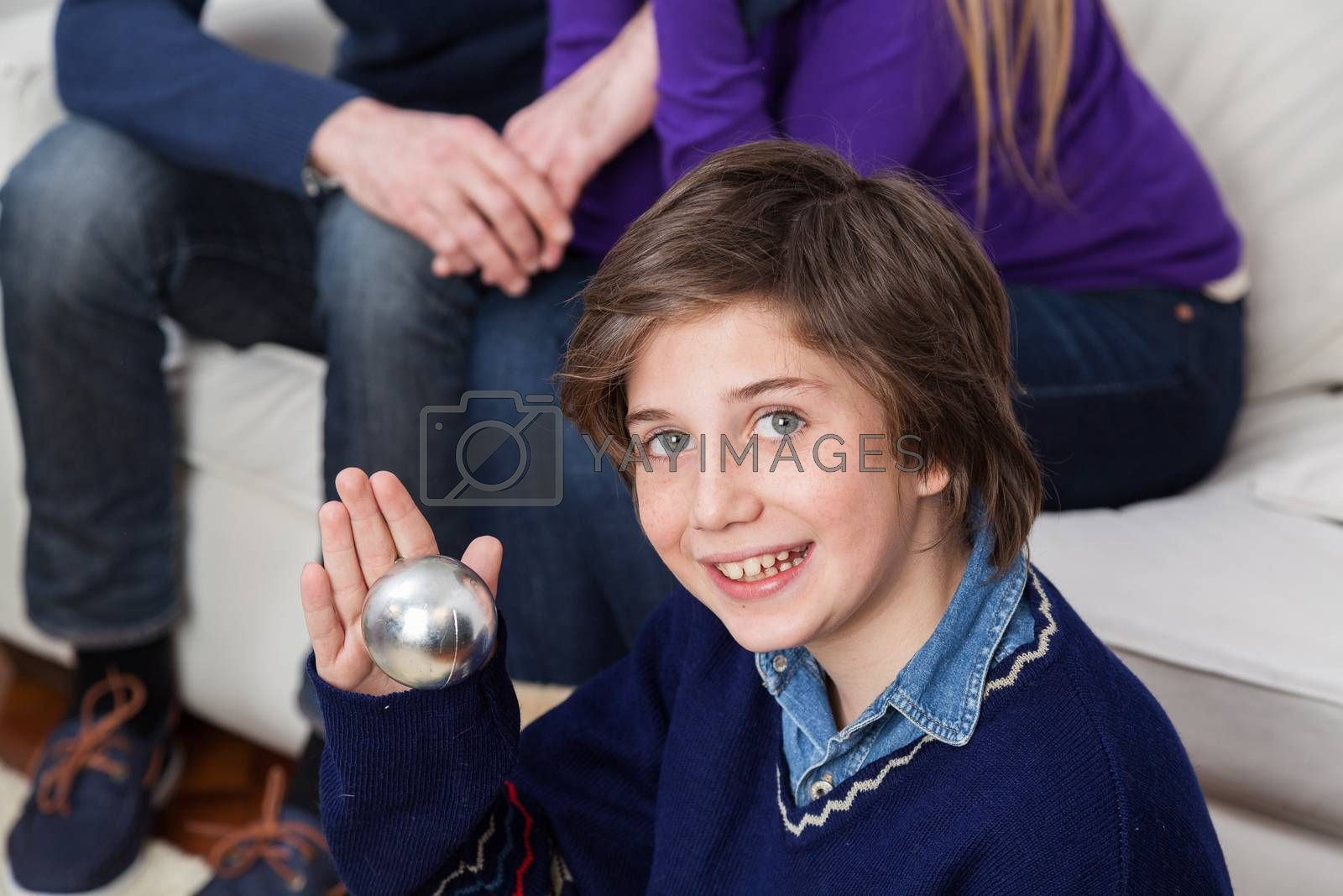 Boy holding a ball of the christmas tree by ifilms