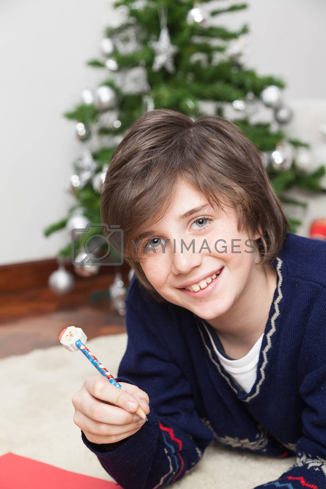 Boy writing a letter from Santa Claus by ifilms