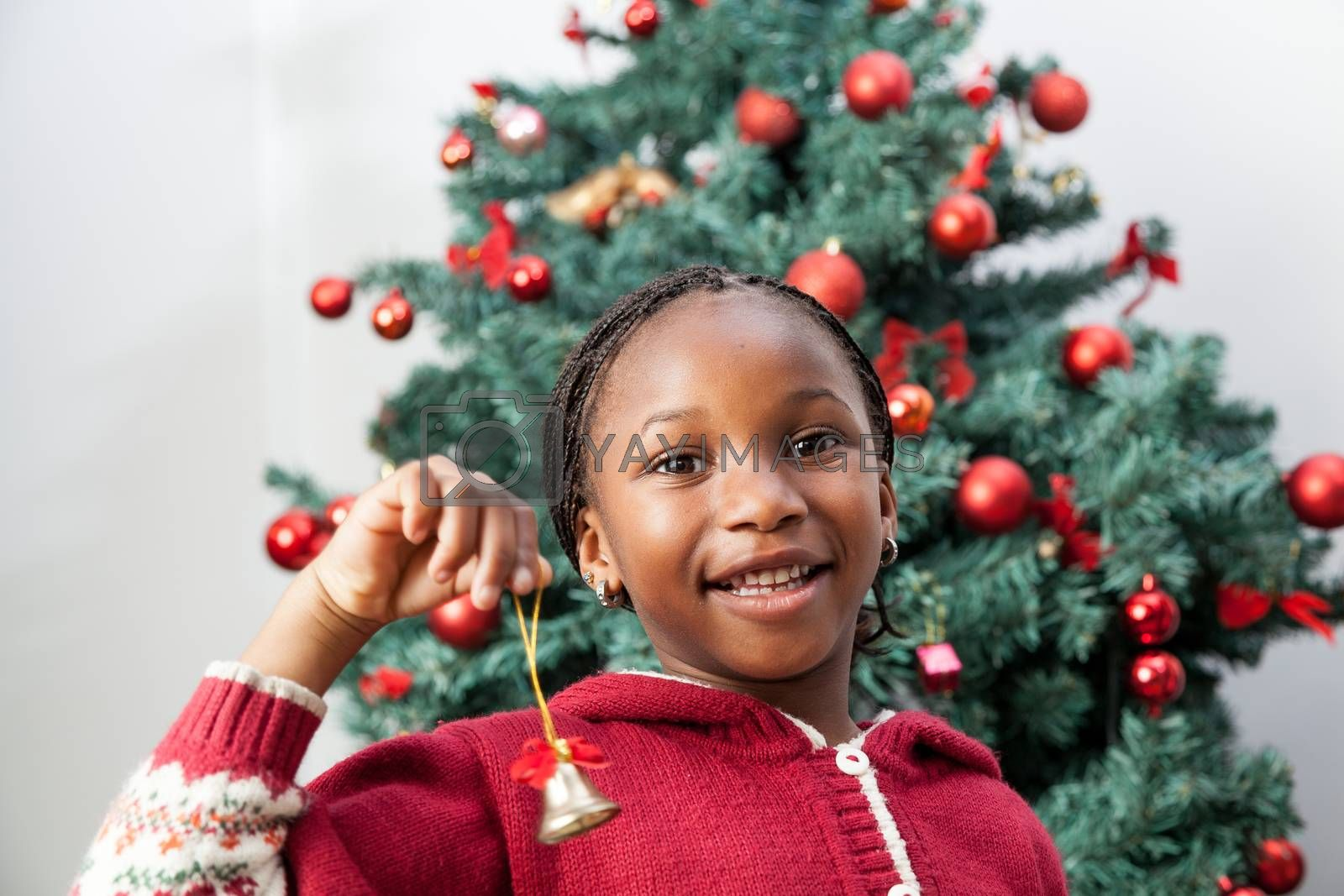 Girl holding Christmas decoration by ifilms