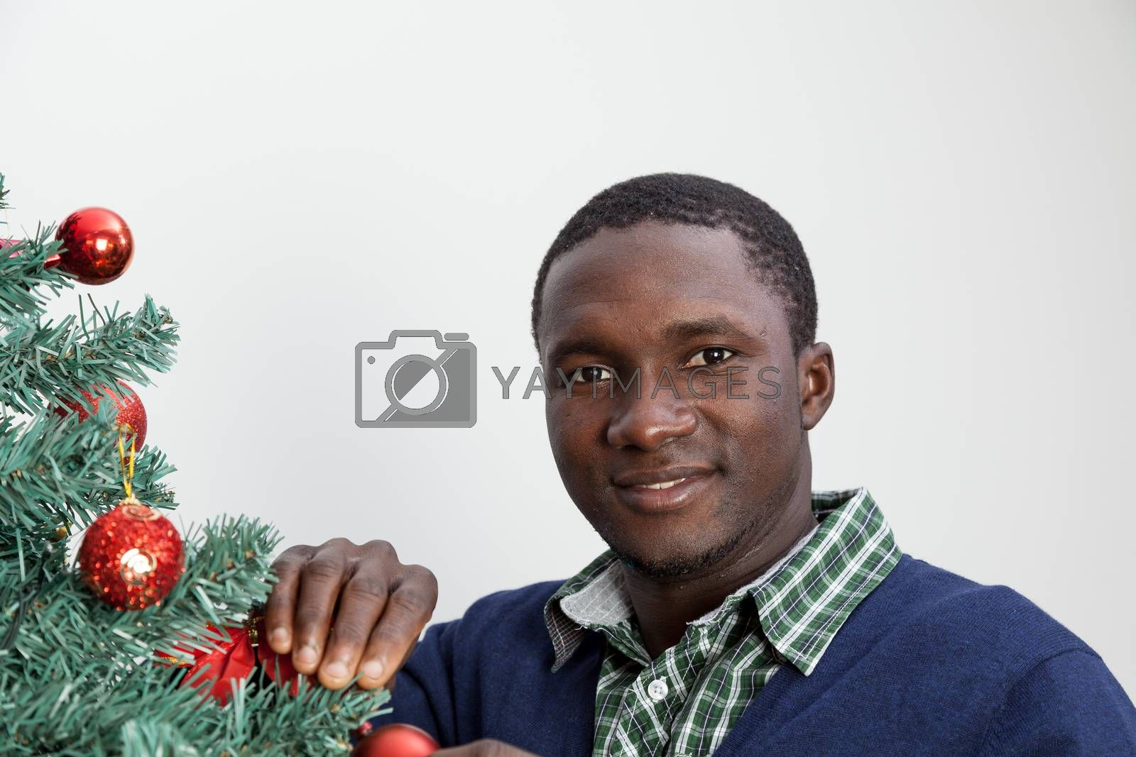 30-35, adult, african, background, balls, beautiful, black, celebration, cheerful, child, christmas, couple, cute, decoration, festive, festivity, handsome, happy, home, house, household, husband, joyful, living, love, male, man, model, old, person, portrait, property, releases, room, smile, smiling, tree, two, vertical, white, wife, xmas, years