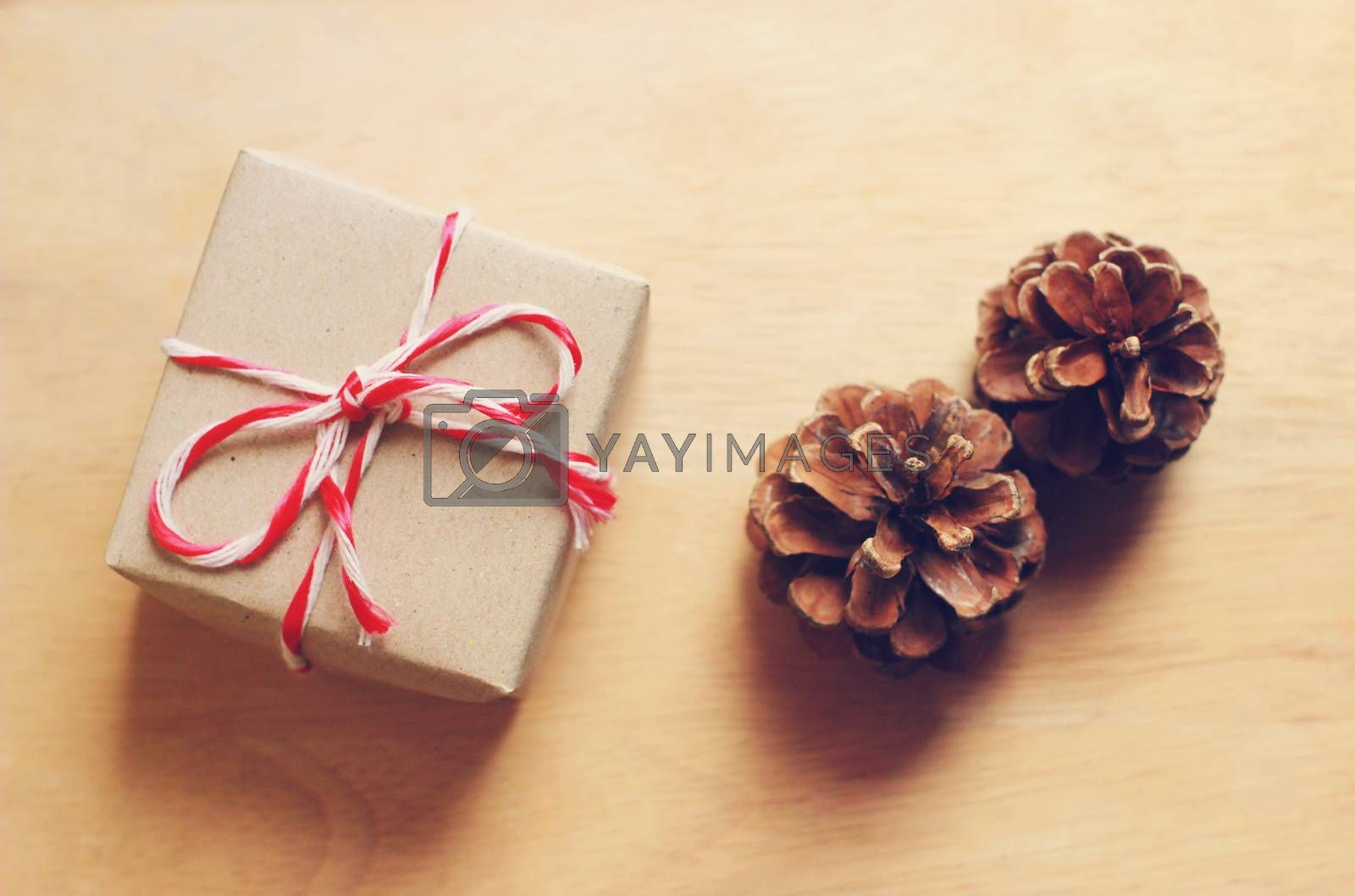 Handmade gift box and pine cone with retro filter effect