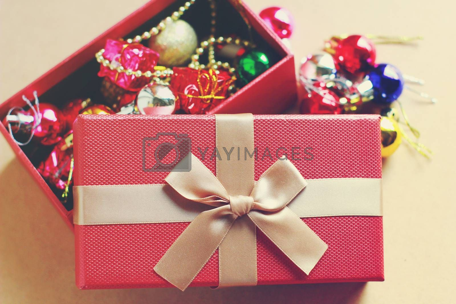 Gift red box contain with christmas ornament, retro filter effect