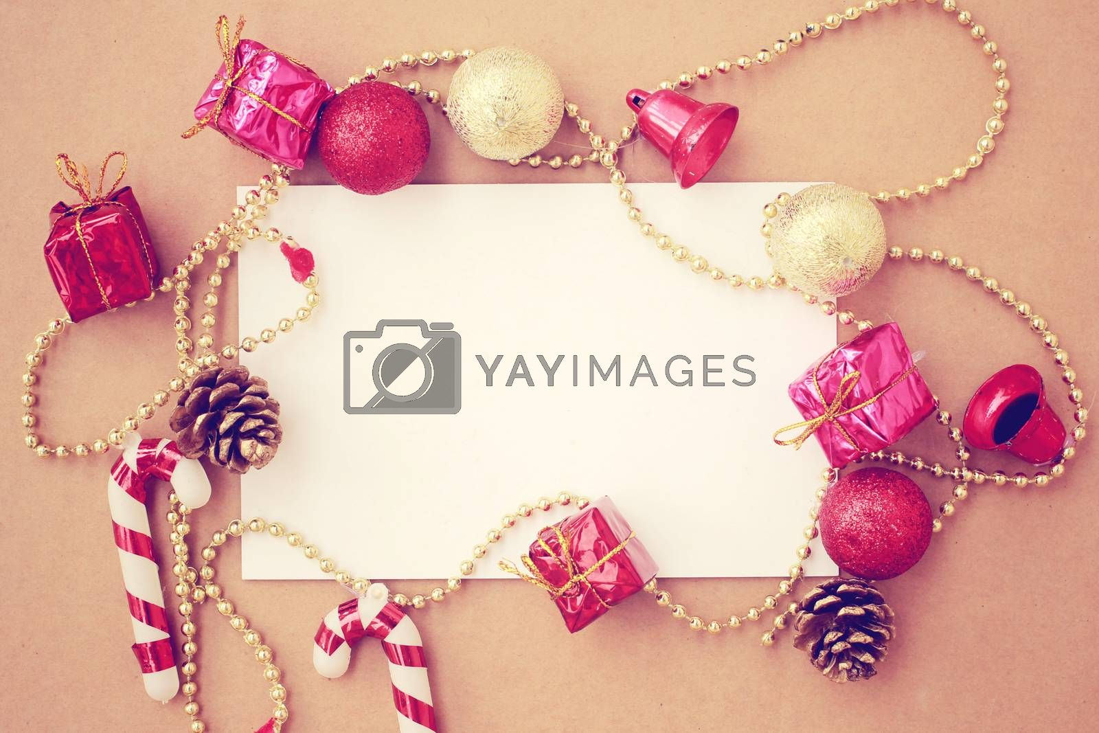 Christmas holiday background with blank greeting card and Christmas decorations, retro filter effect