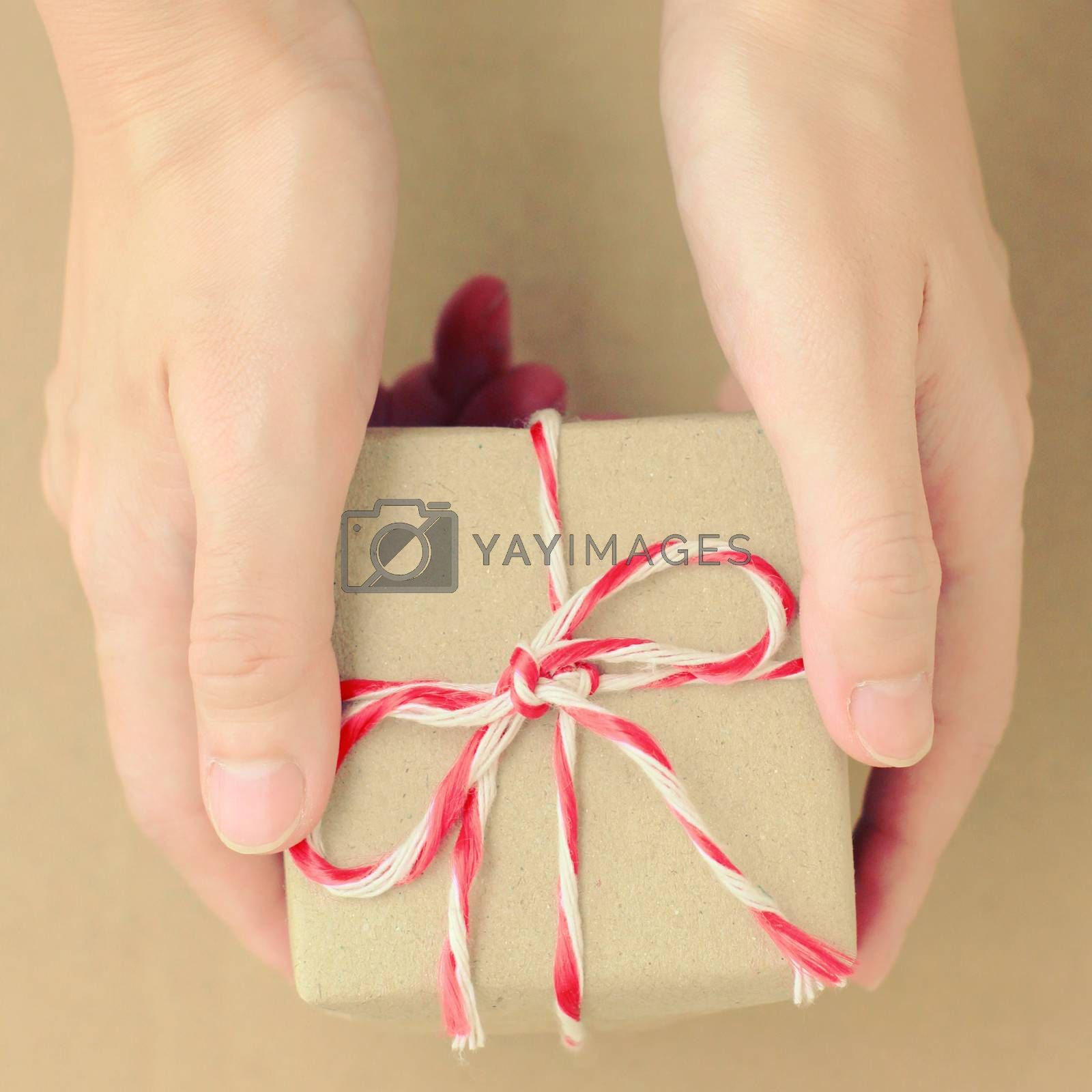 Hand holding gift box with retro filter effect