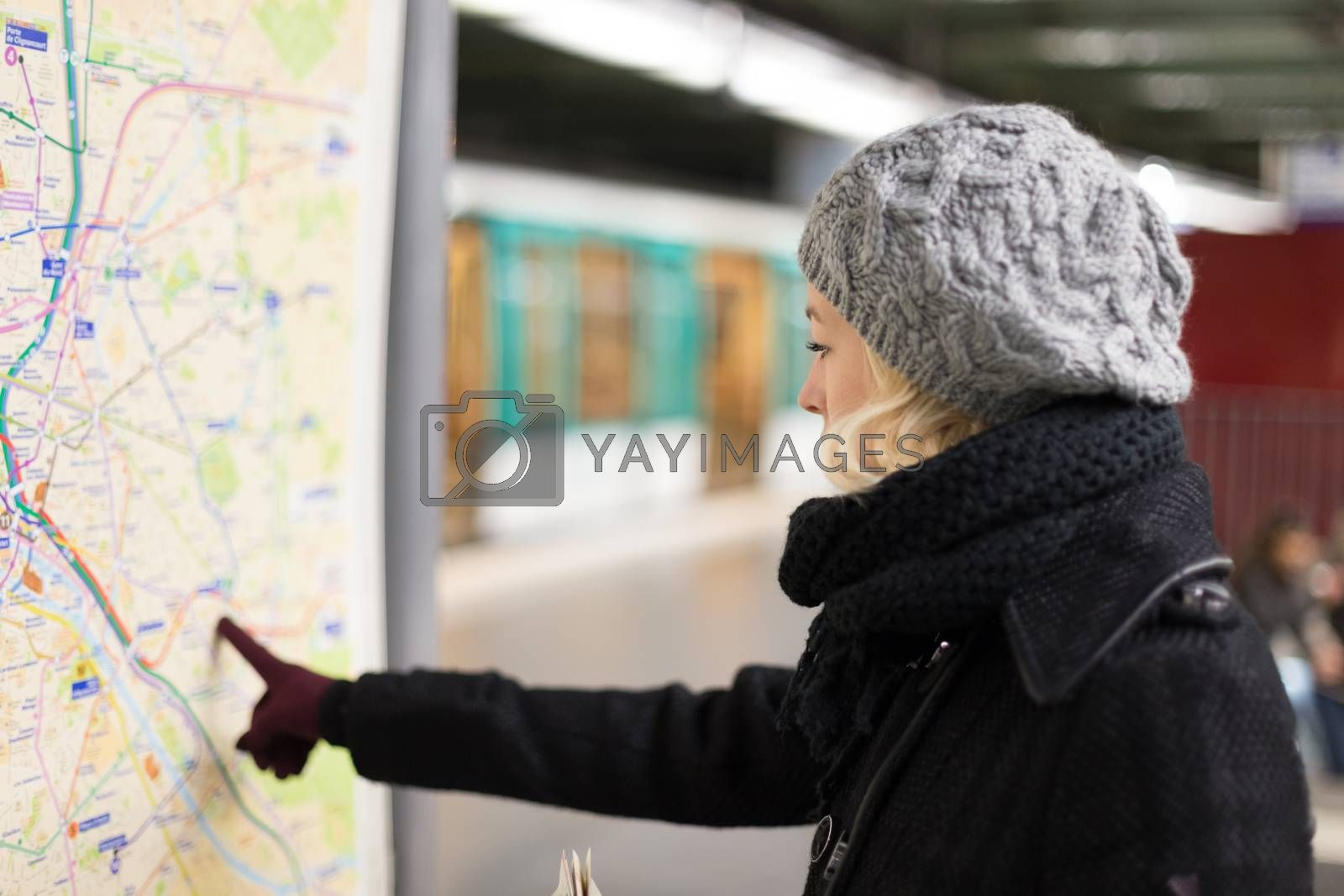 Lady looking on public transport map panel. by kasto