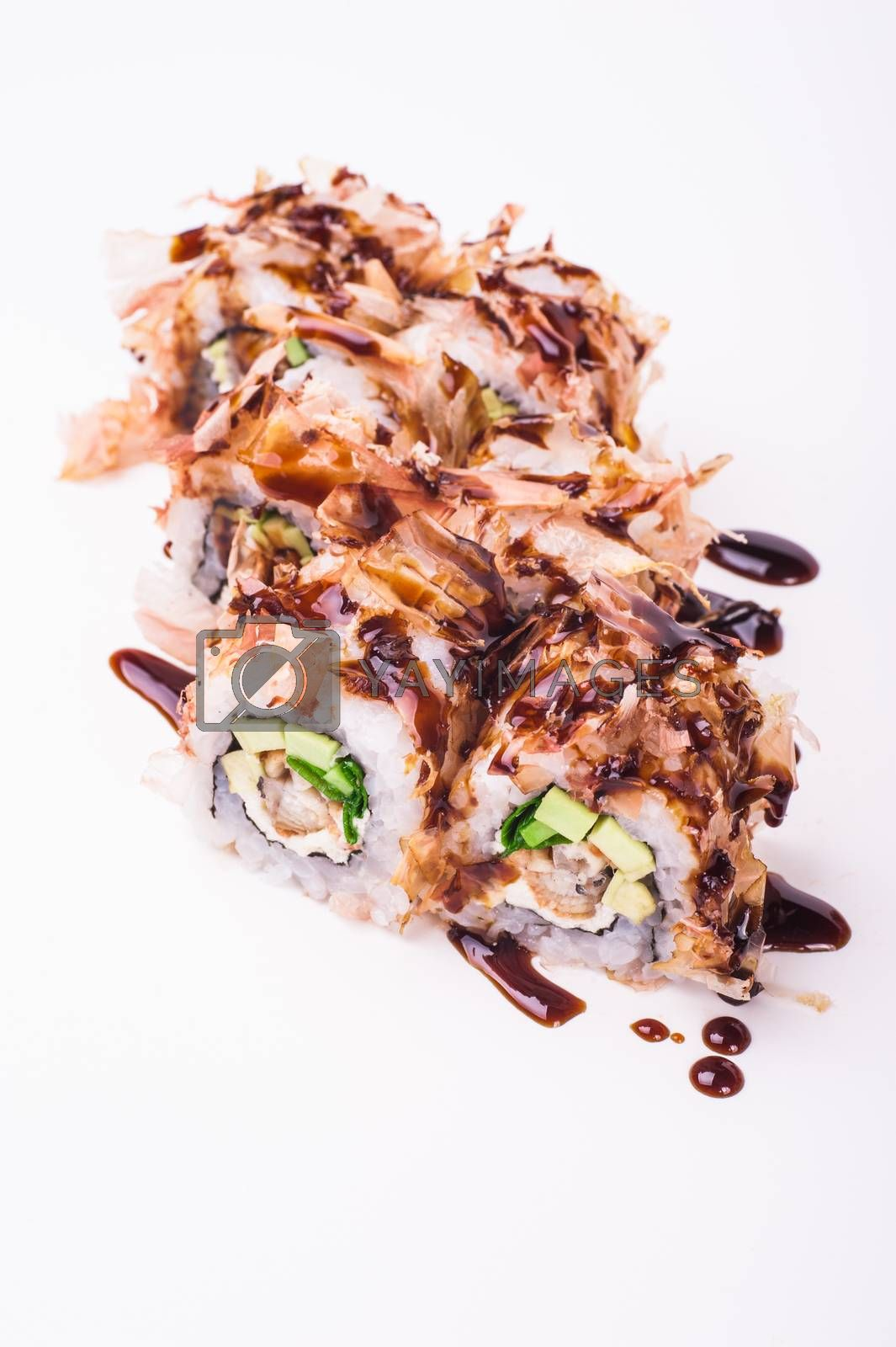eel sushi roll in tuna flakes isolated on white background