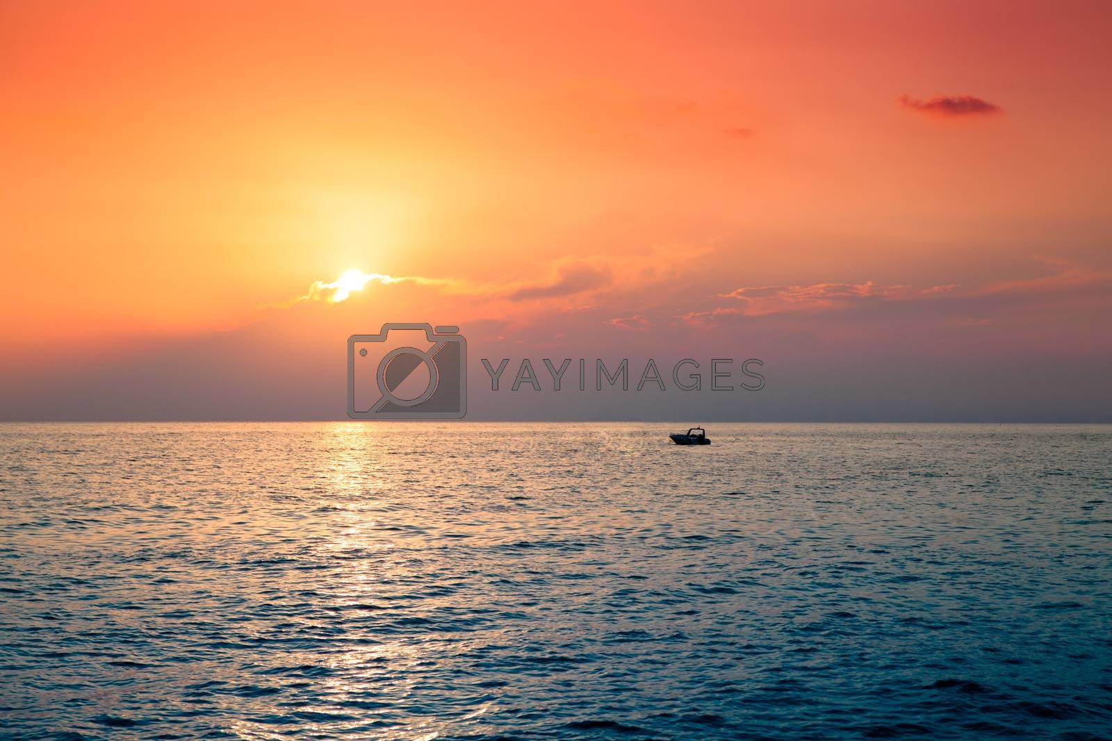 Lone boat in the sea at the beautiful sunset
